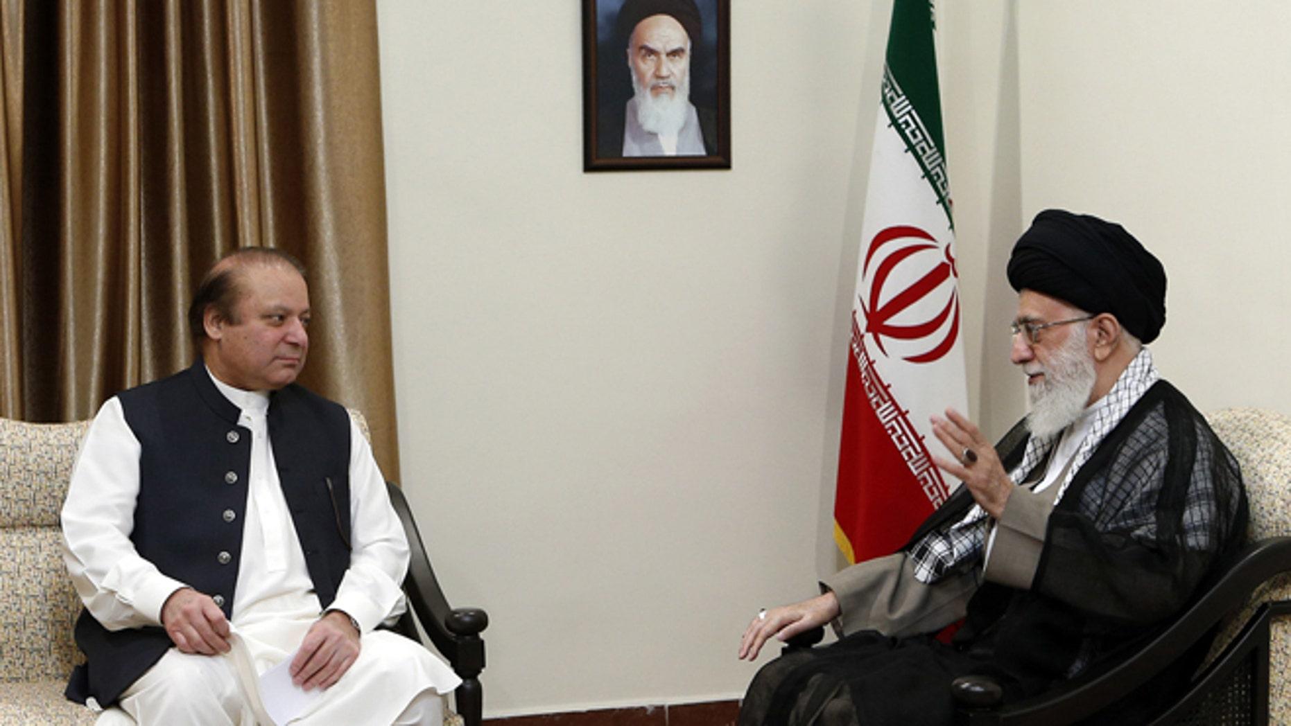 May 12, 2014: Iranian supreme leader, Supreme Leader Ayatollah Ali Khamenei, right, speaks with Pakistani Prime Minister Nawaz Sharif during their meeting in Tehran, Iran. (AP/Office of the Iranian Supreme Leader)