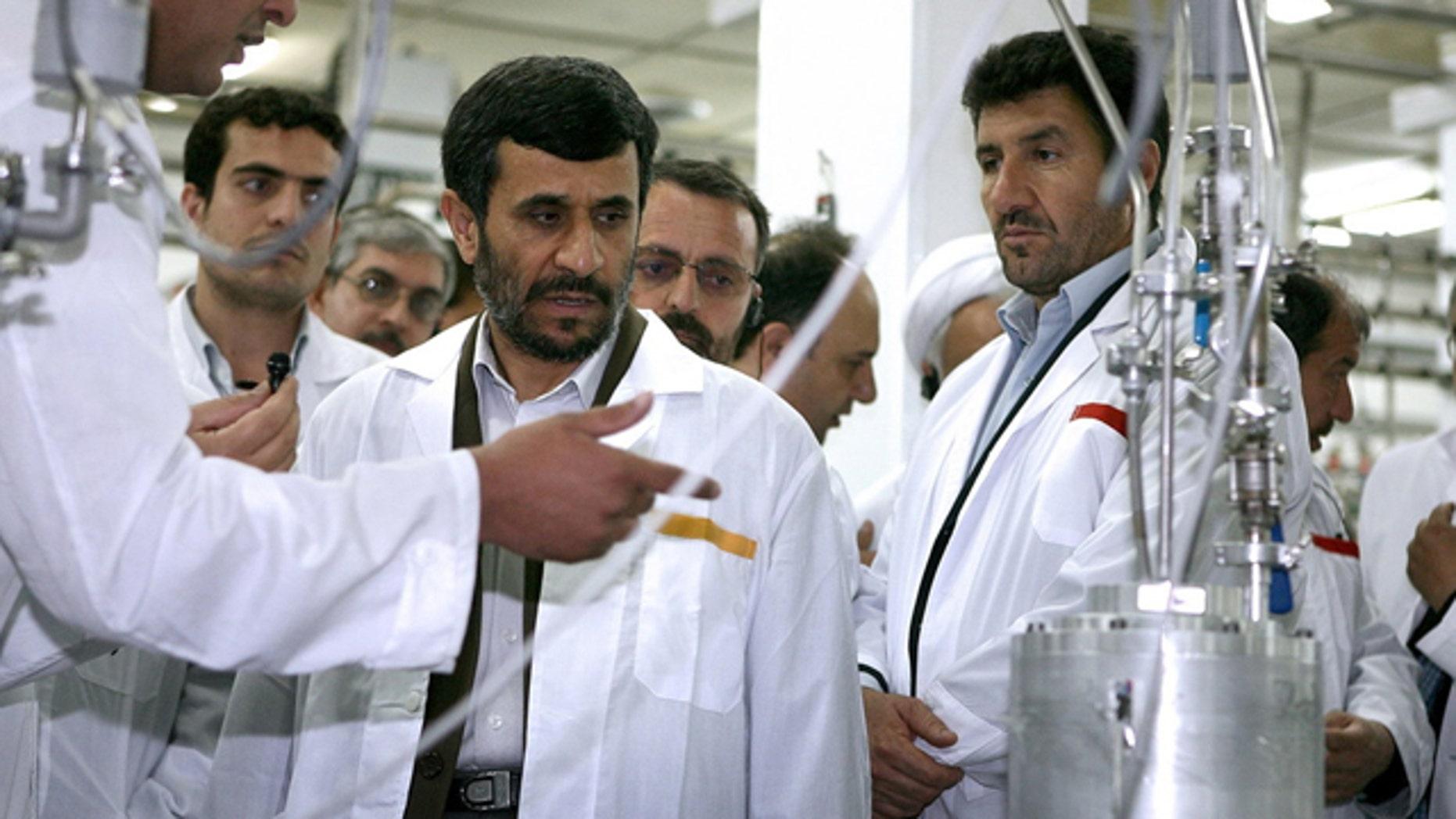 FILE: April 2008: President Mahmoud Ahmadinejad listens to a technician during his visit of the Natanz Uranium Enrichment Facility.