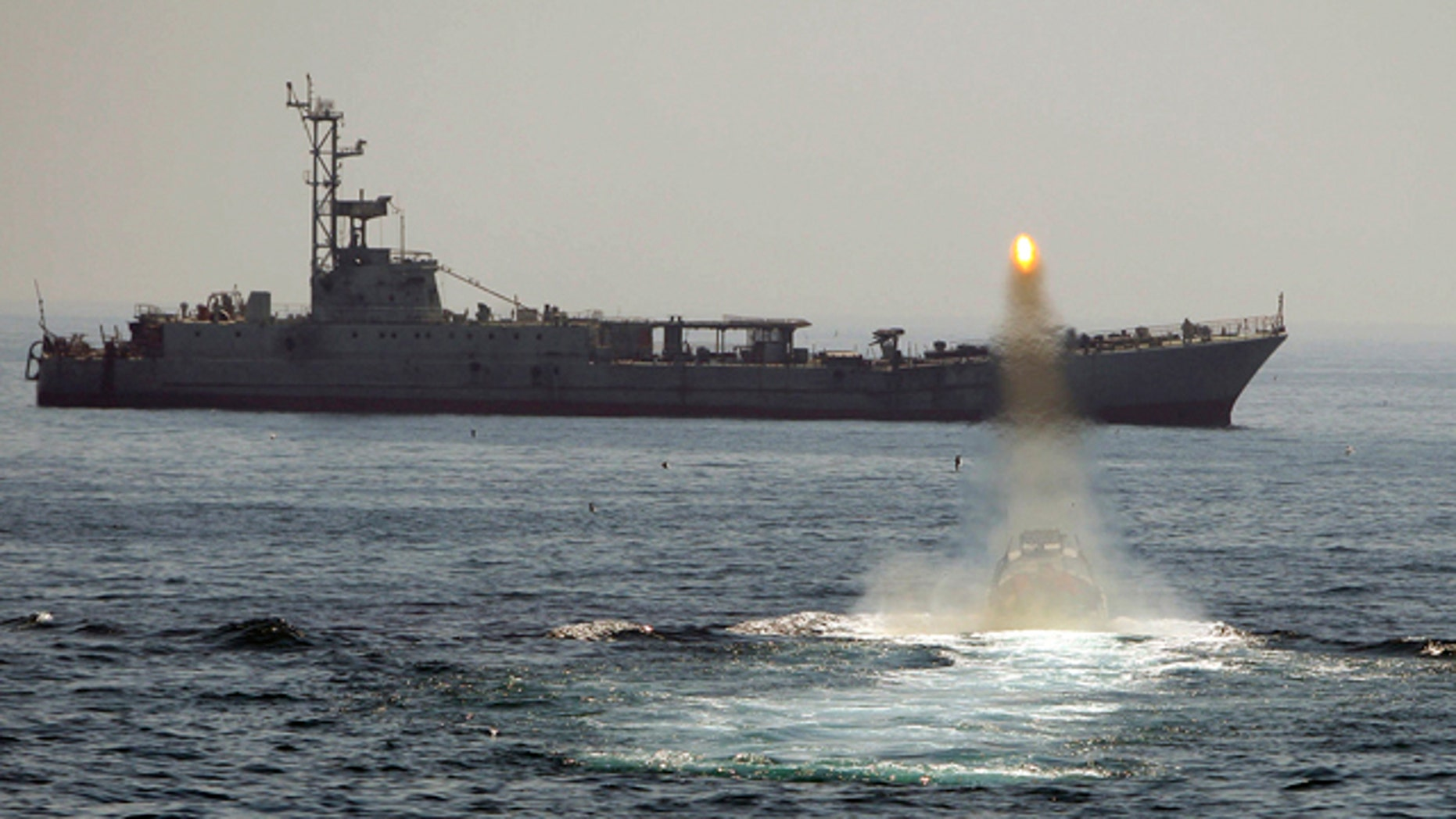 April 2010: An Iranian warship and speed boats take part in a naval war game in the Persian Gulf and the Strait of Hormuz, southern Iran.