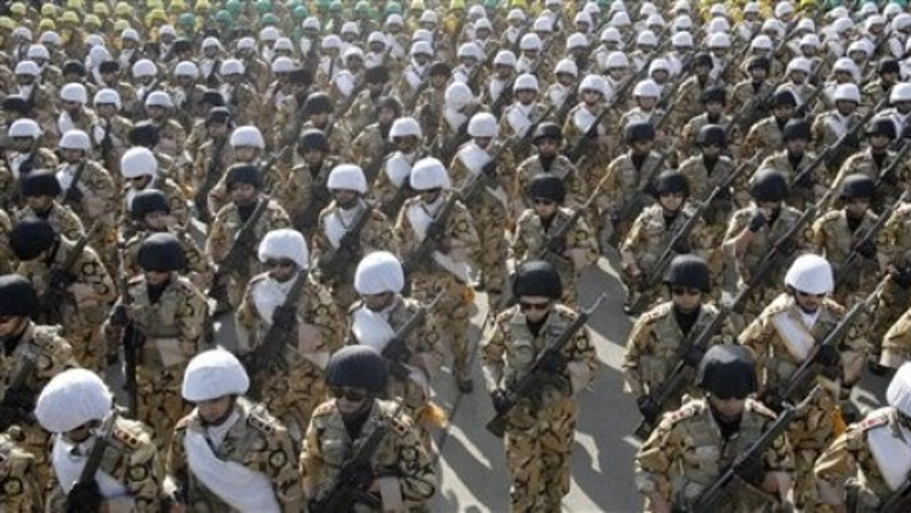 April 17, 2012: Iranian troops march during a military parade commemorating National Army Day in front of the mausoleum of the late revolutionary founder Ayatollah Khomeini, outside Tehran, Iran.
