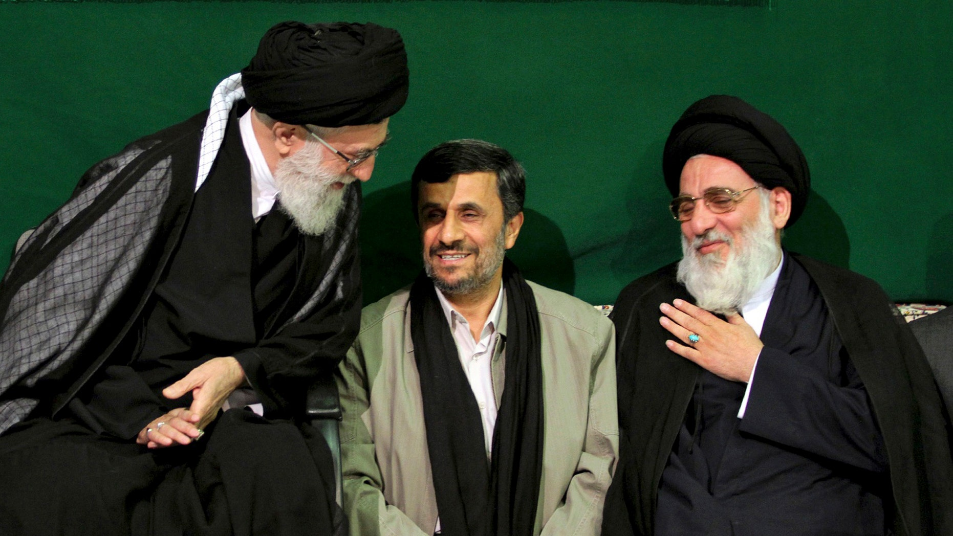 In this Saturday, May 7, 2011 photo released by an official website of the Iranian supreme leader's office, Iranian supreme leader Ayatollah Ali Khamenei, left, greets former Judiciary chief Ayatollah Mahmoud Hashemi Shahroudi, right, as President Mahmoud Ahmadinejad sits at center, during a religious ceremony, in Tehran, Iran. (AP)