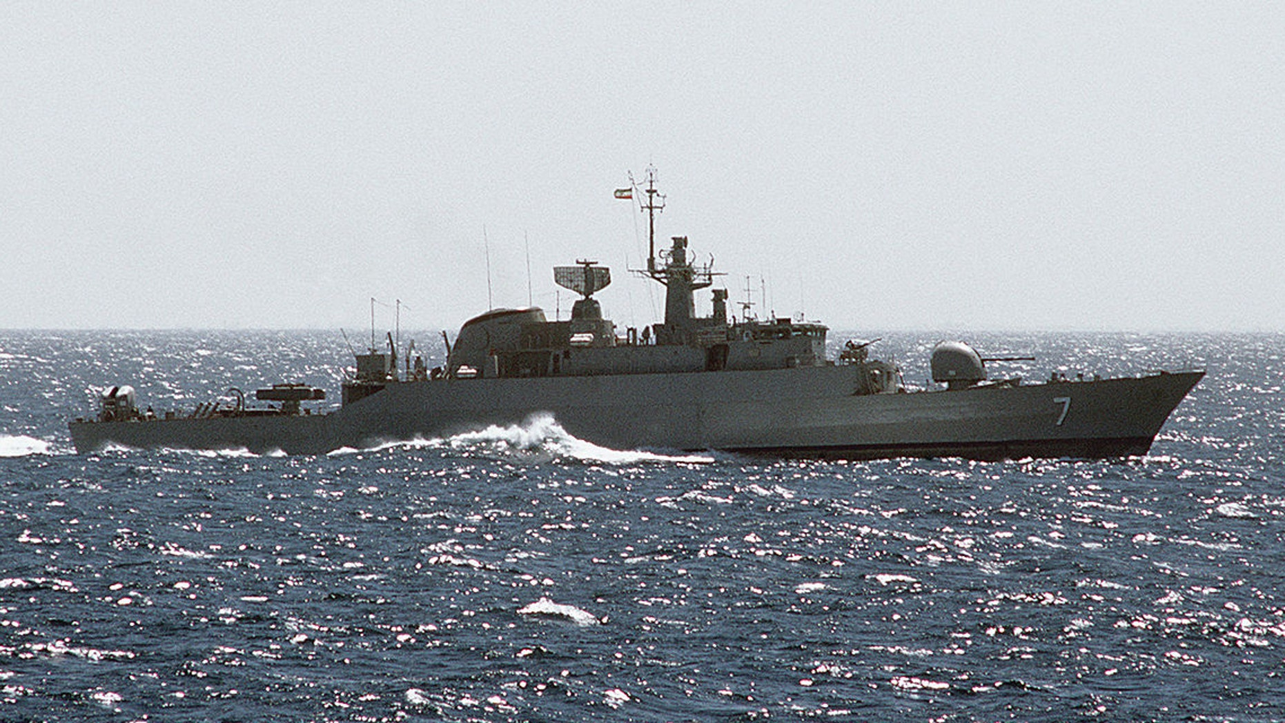 """A starboard beam view of an Iranian Alvand-class frigate. Iran's Islamic Revolutionary Guard is expected to put 100 gun boats in the Persian Gulf soon to practice """"swarm"""" tactics, U.S. officials have said."""