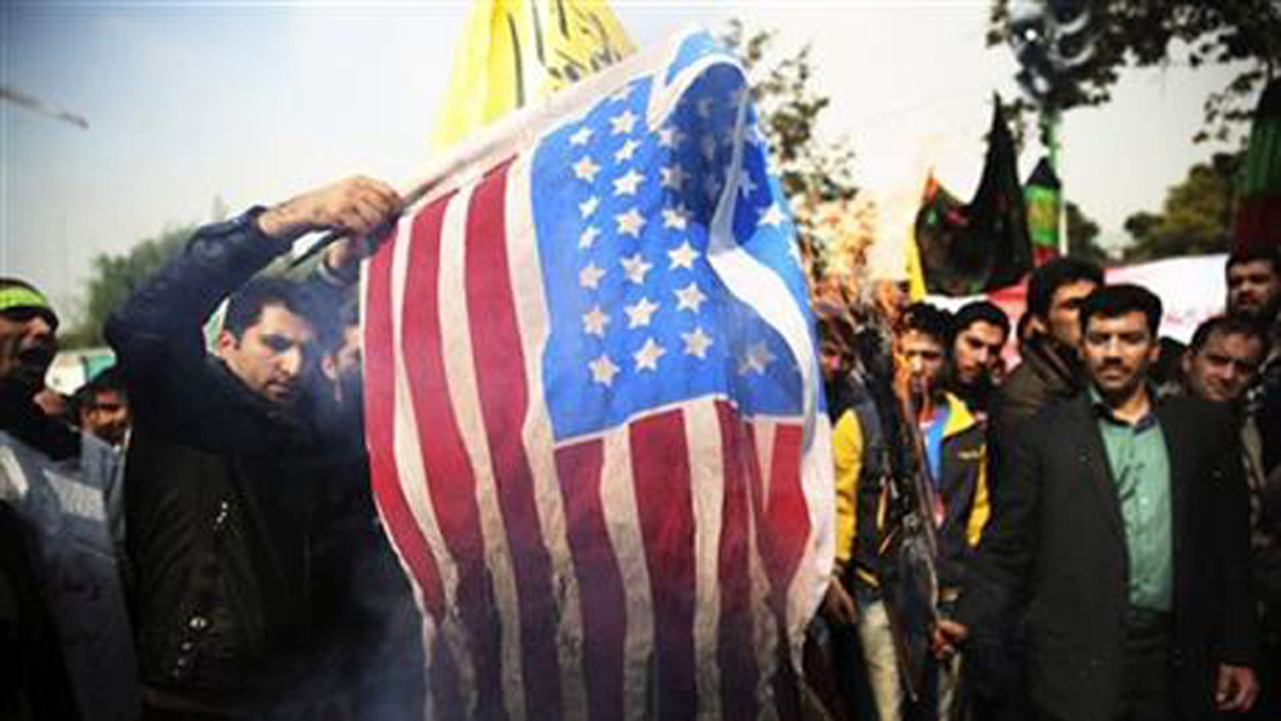 Sanctions on Iran are causing economic hardship, but may be making strapped Iranians angrier with the Us> than their own leaders. (AP)