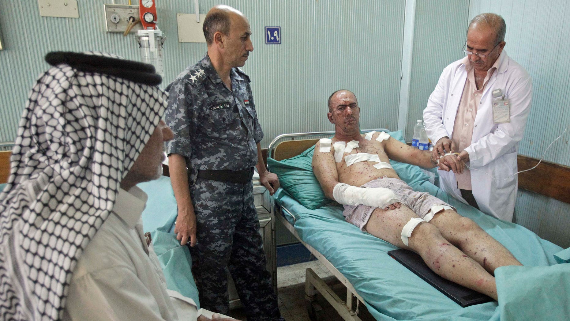September 14: An Injured man receives treatment at a Hospital in Hillah, about 60 miles (95 kilometers) south of Baghdad, Iraq. A car bomb went off outside a restaurant where local police were having breakfast Wednesday morning, killing and wounding scores of people, police said.