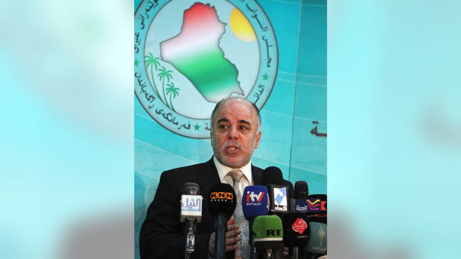 FILE - In this Saturday, Dec. 5, 2009 file photo, Shiite lawmaker Haider al-Abadi speaks to the press after an Iraqi Parliament session about the election law in Baghdad, Iraq. On Monday, Aug. 11, 2014, Iraq's largest coalition of Shiite political parties chose the Deputy Parliament Speaker Haider al-Ibadi to be its candidate to lead the government in a major defeat for incumbent Prime Minister Nouri al-Maliki just hours after he declared himself the rightful candidate and put troops on the street. Critics say the Shiite al-Maliki contributed to the crisis by monopolizing power and pursuing a sectarian agenda that alienated the country's Sunni and Kurdish minorities. (AP Photo/Karim Kadim, File)
