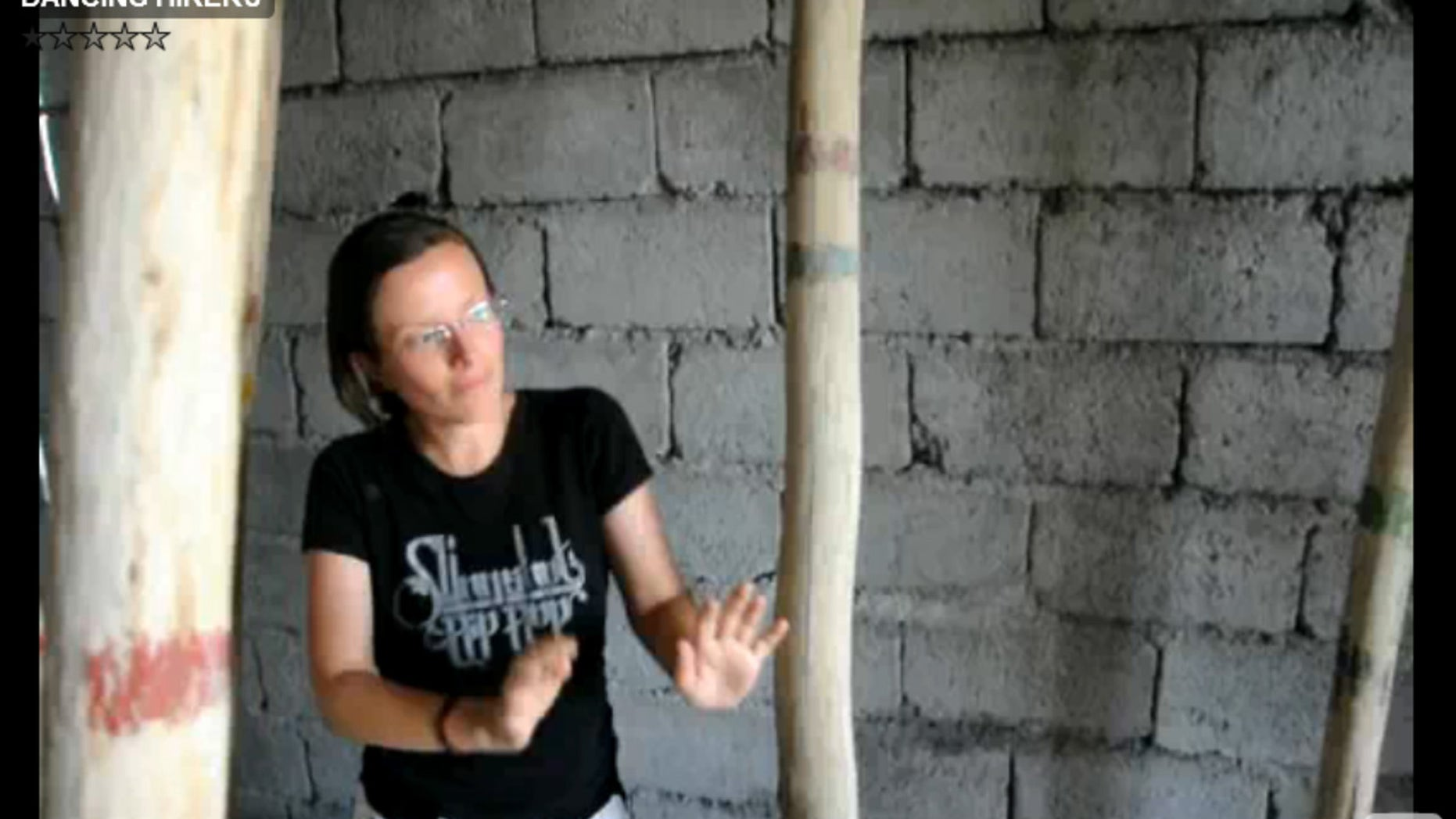 This image made from a July 29, 2009 video released Tuesday, Oct. 27, 2009 by Shon Meckfessel and the families of Shane Bauer, Sarah Shourd and Josh Fattal, shows Shourd dancing in an unfinished cinder block building in the Kurdish city of Irbil, Iraq. The families of three Americans being held in Iran released video footage Tuesday that they say proves the three were simply on vacation and had no underhand intentions when they strayed across the border. (AP Photo/Shon Meckfessel)  NO SALES