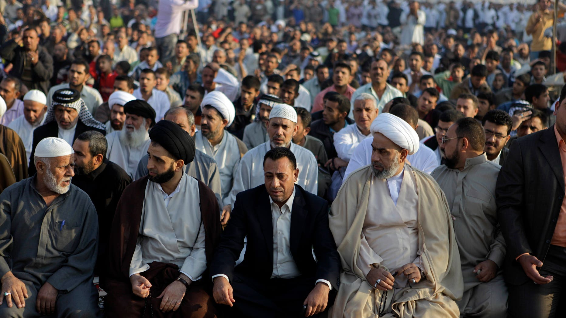 File photo showing followers of radical Shiite cleric Muqtada al-Sadr crowding a street as they attend open air Friday prayers in Sadr City, Baghdad.