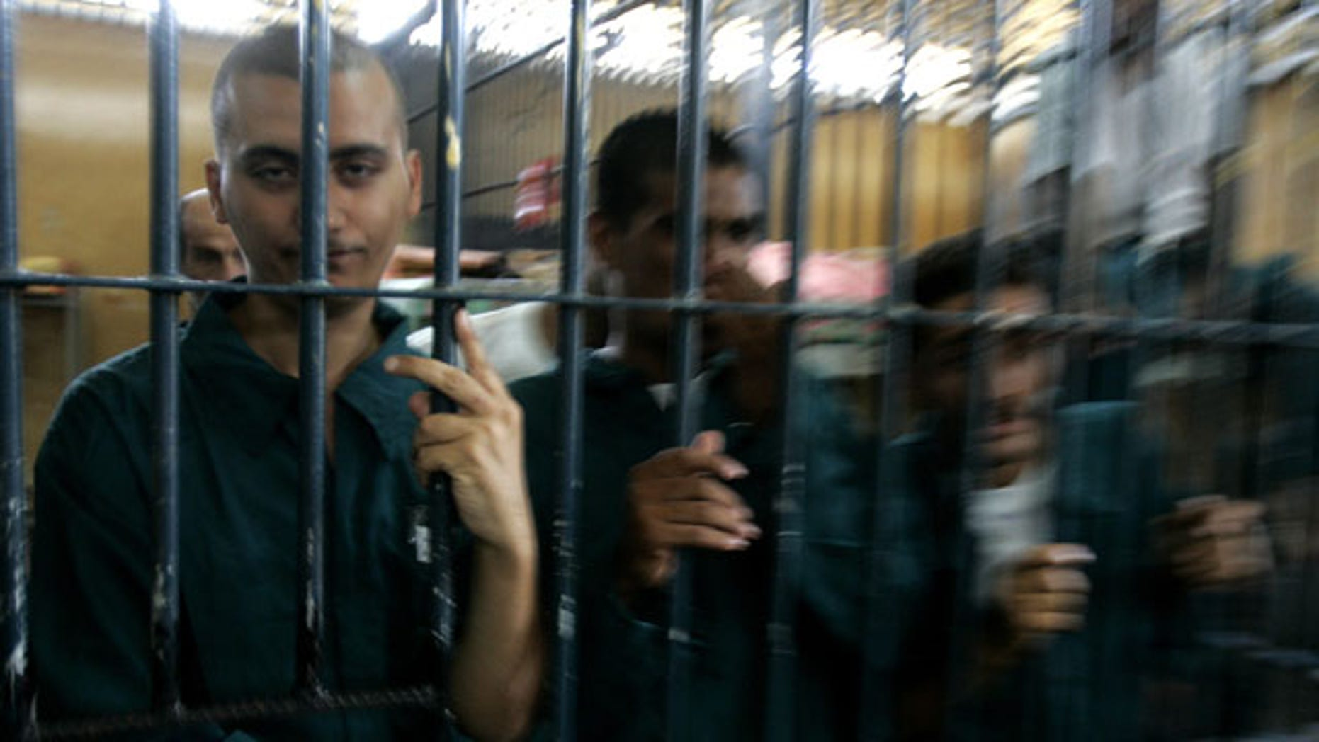 Aug. 28, 2007: Prisoners look out of their cell in the Rusafa 5 intake prison inside the new judicial Green Zone in Baghdad, Iraq. Military documents in the biggest leak of secret information in U.S. history suggest that U.S. forces often failed to follow up on credible evidence that Iraqi forces mistreated, tortured and killed their captives as they battled a violent insurgency.