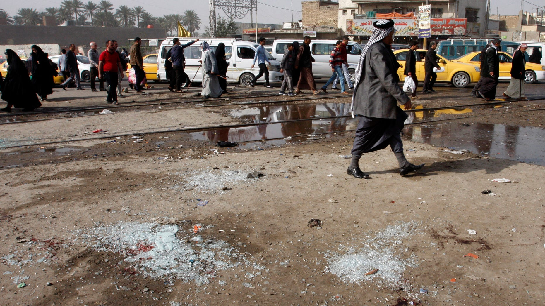 Feb. 9, 2015 - Broken glass at the scene of a suicide bomb attack at Adan Square, in a predominantly Shiite part of Baghdad, Iraq. The attack and another in the northeastern suburb of Husseiniyah in Baghdad killed at least 22 people and wounded dozens.
