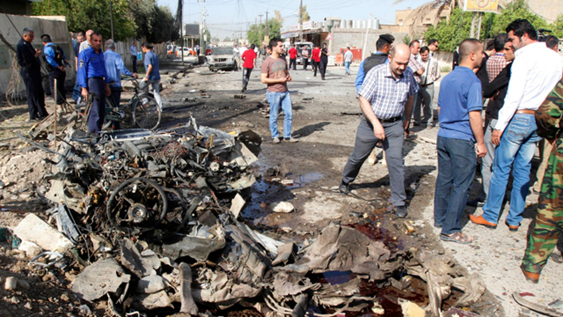 April 15, 2013: Iraqi security personnel are seen at the site of a bomb attack in Kirkuk.