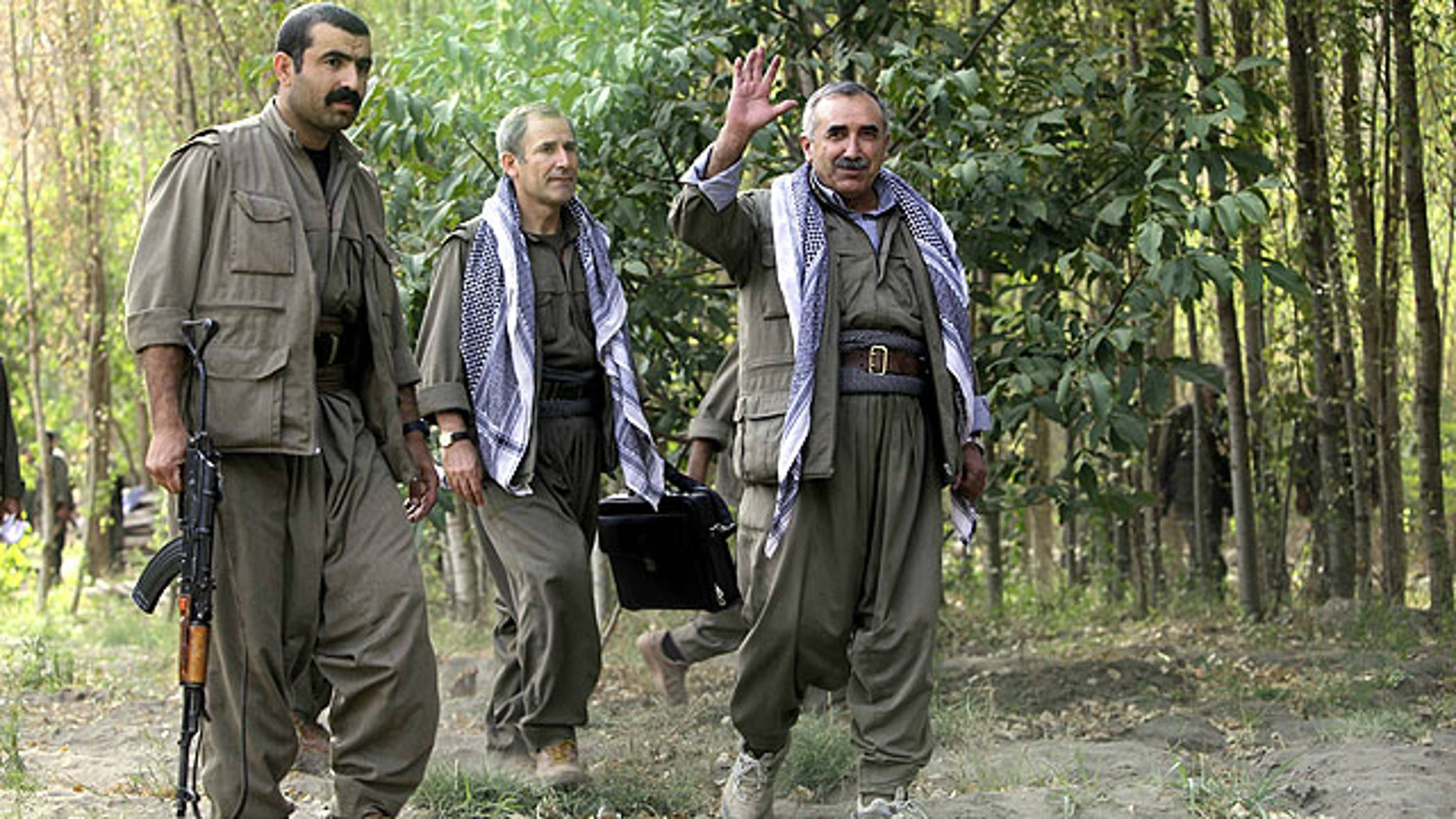 Sept. 30, 2010: Murad Karialan, right, and Bouzan Teken, center, of the Kurdistan Workers' Party, or PKK, speaks to the press in the Qandil mountain range, northern Iraq.