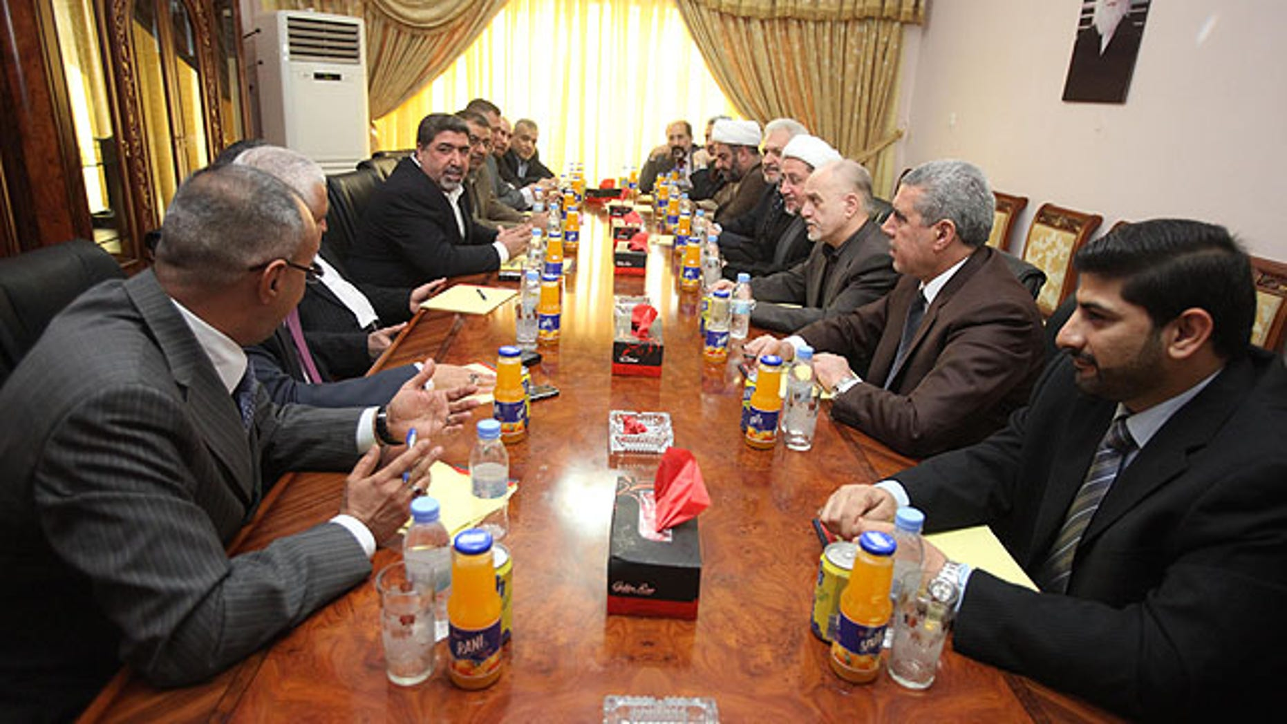 Oct. 1, 2010: Representatives of Shiite cleric Muqtada al-Sadr and Iraqi Prime Minister Nouri  al-Maliki's political parties meet in Baghdad, Iraq.