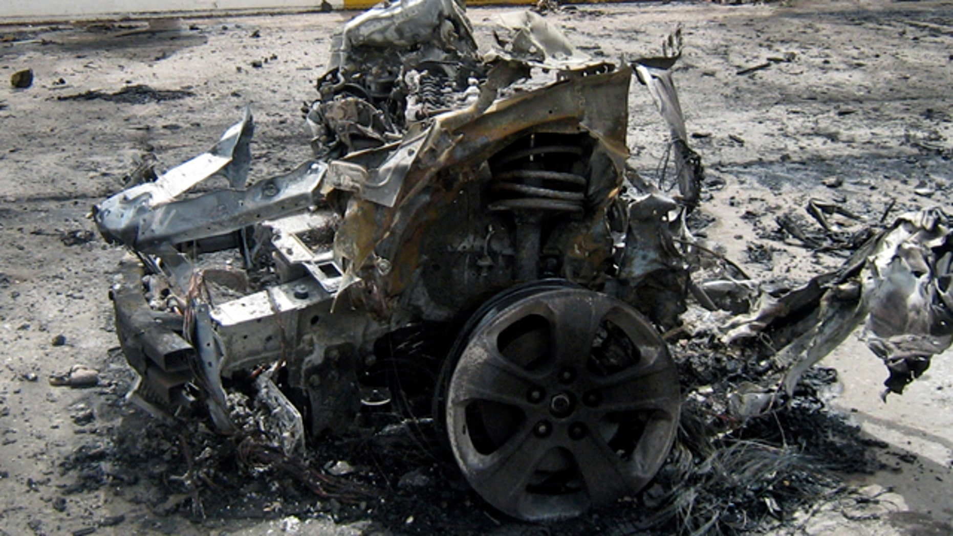 April 18: Iraqi army soldiers secure the scene of a suicide car bomb in Baghdad, Iraq.