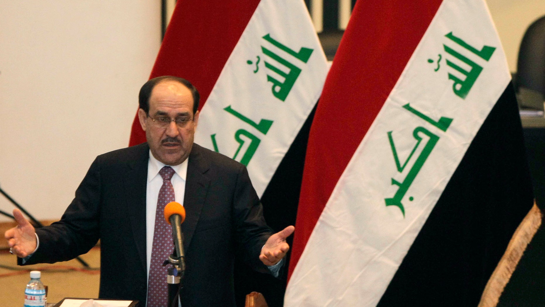 Dec. 21: Iraq's Prime Minister Nouri al-Maliki speaks to the Iraqi lawmakers before submitting his new government for approval in Baghdad, Iraq.
