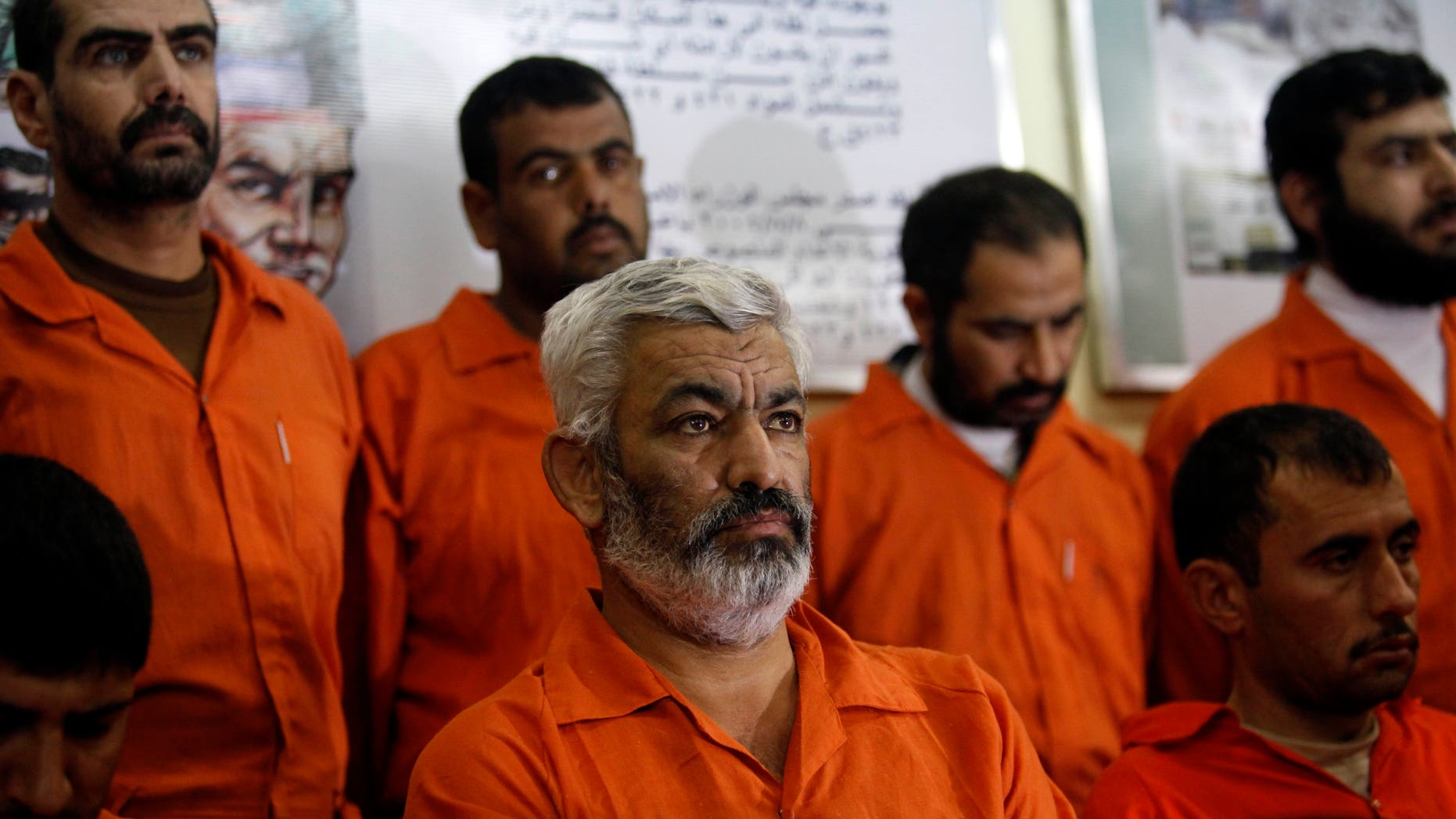 Handcuffed Al Qaeda-linked suspects sit in a terrorist combat and organized crime department in Baghdad, Iraq, Thursday, Dec. 2, 2010. Iraq's interior minister called Thursday for the death penalty for a group of 39 Al Qaeda-linked suspects even before they have been put on trial for allegedly plotting to bomb targets in Baghdad.