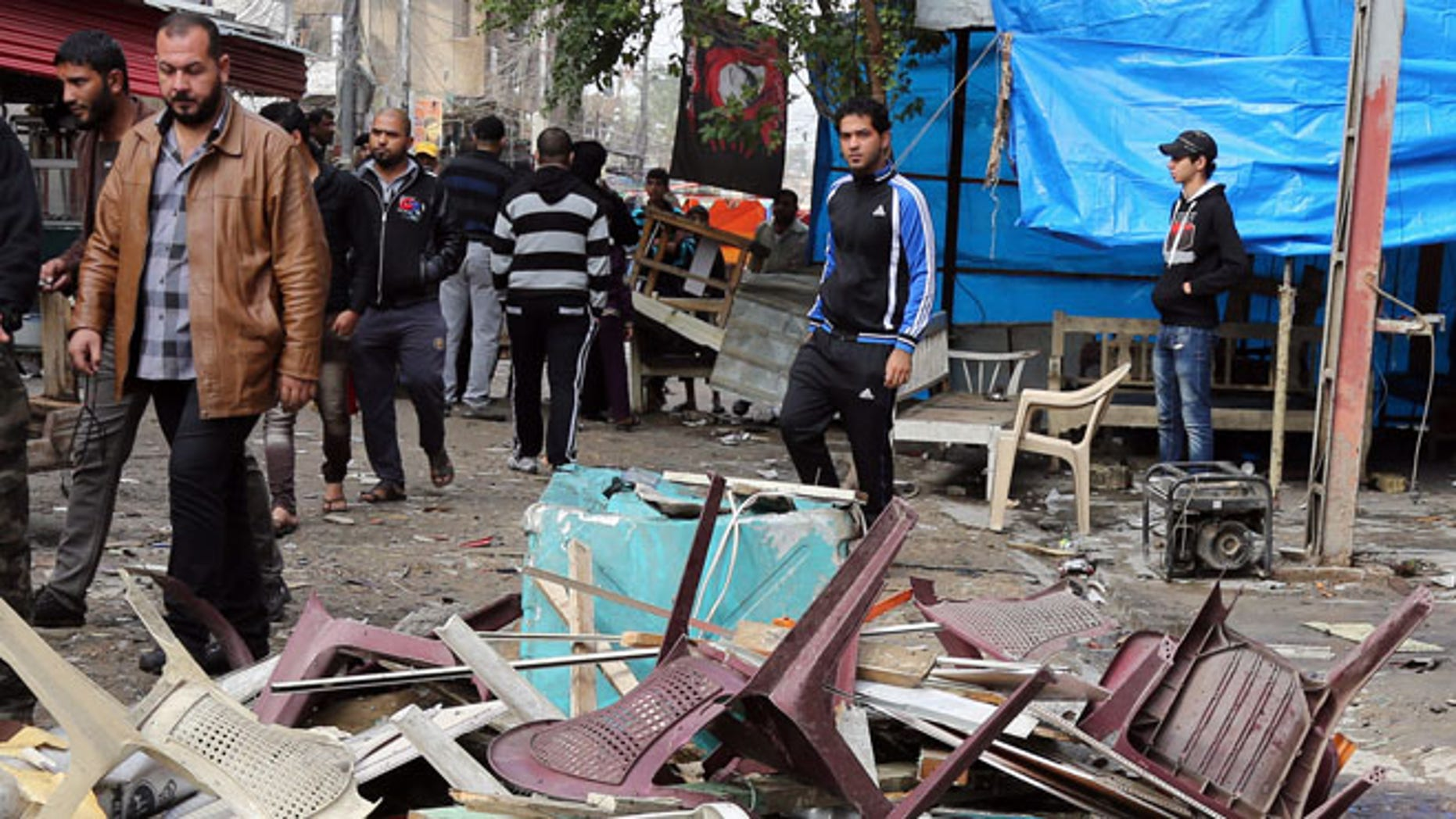 Nov. 21, 2013: Iraqis inspect the aftermath of a late-night bombing at a cafe in Bayaa neighborhood, southwestern Baghdad, Iraq.