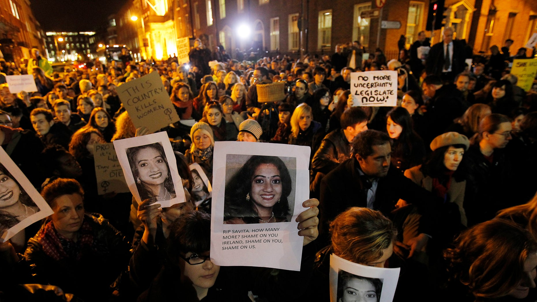 Nov. 14, 2012: Protestors outside Leinster House in Dublin against the death in October of Savita Halappanavar, pictured, a dentist aged 31, who was 17 weeks pregnant, after suffering a miscarriage and septicaemia.