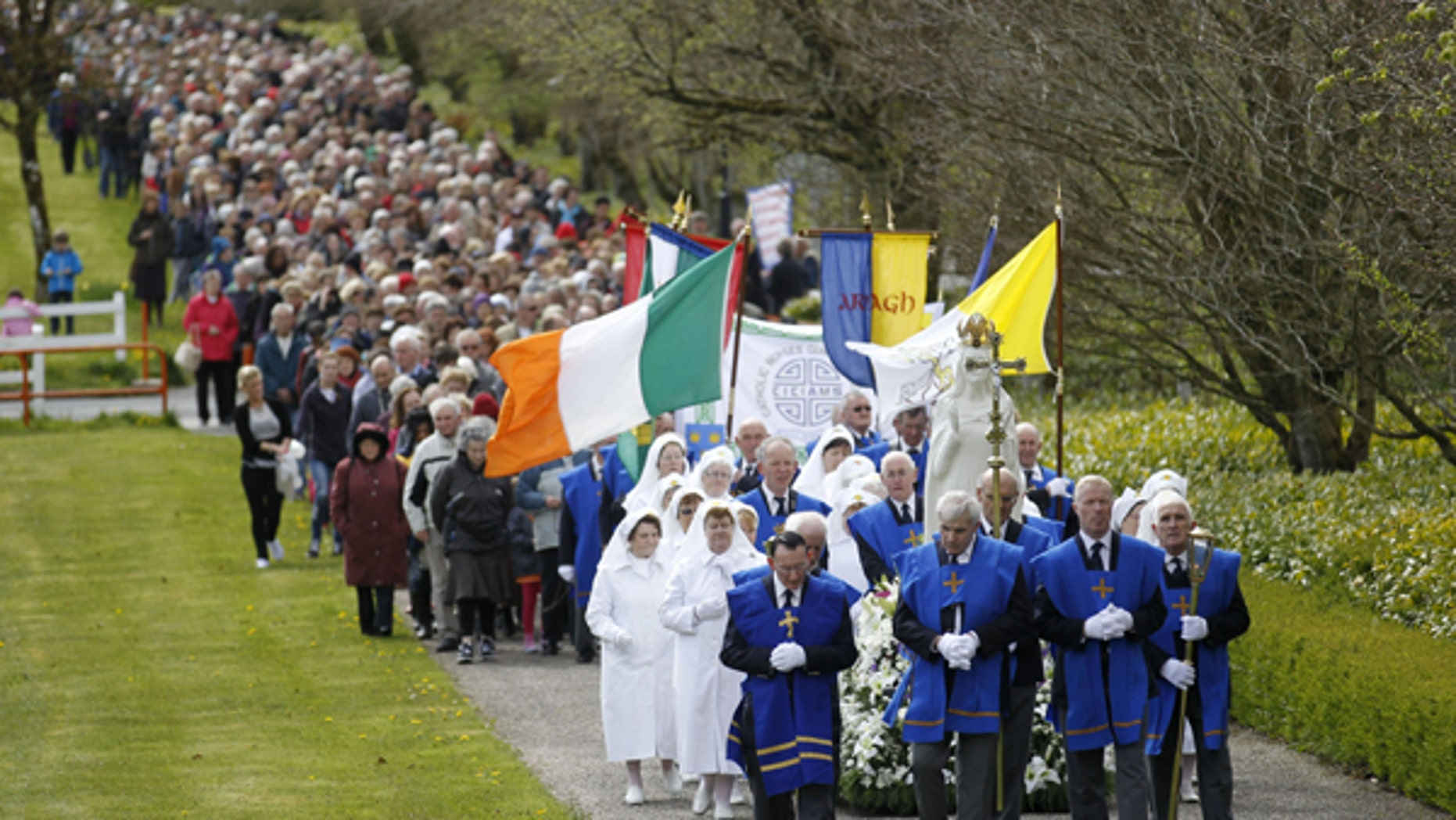 In this Saturday, May 4, 2013 file photo thousands of Roman Catholics take part in a Rosary Procession at Knock Shrine, Ireland. The group Chooselife held a National Prayer Vigil for the right to life of mothers and babies during a service at Knock Shrine.
