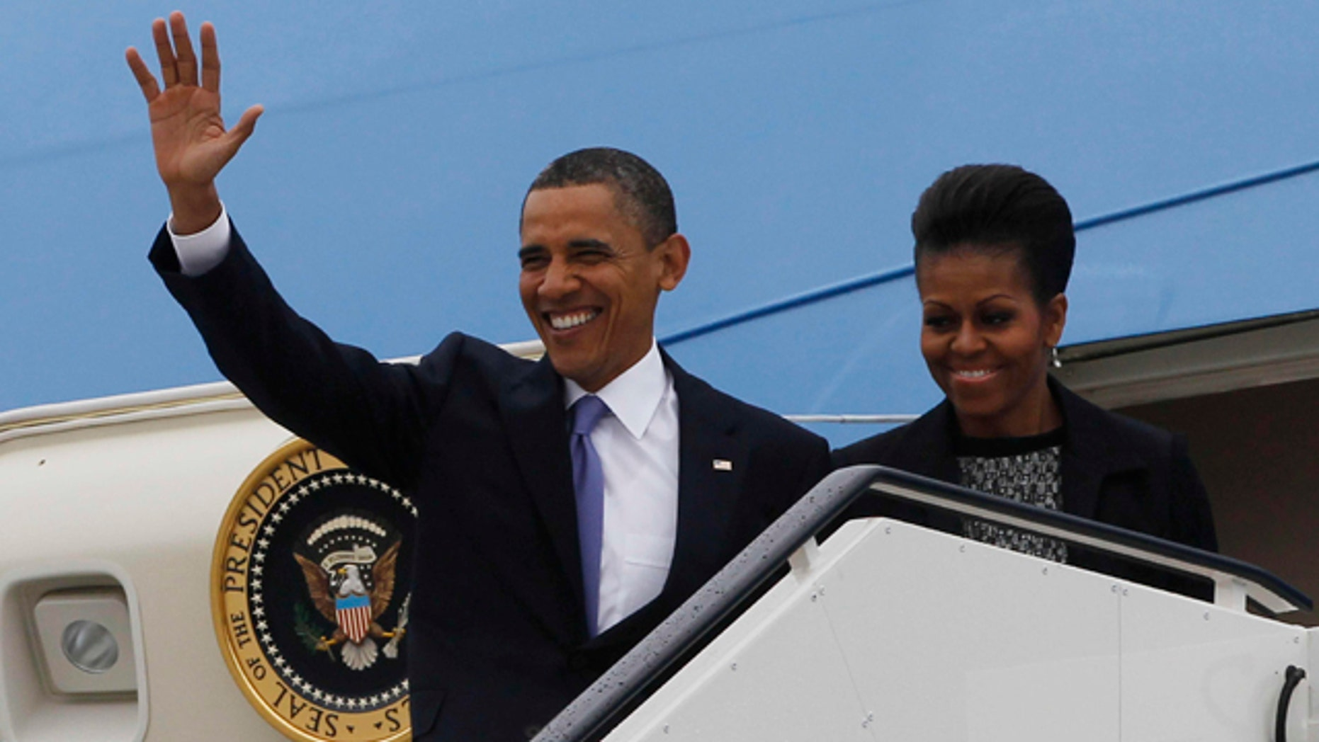May 23: U.S. President Barack Obama and first lady Michelle Obama step off Air Force One as they arrive in Dublin, Ireland. President Barack Obama opens a six-day European tour with a quick dash through Ireland, where he will celebrate his own Irish roots and look to give a boost to a nation grappling with the fallout from its financial collapse.