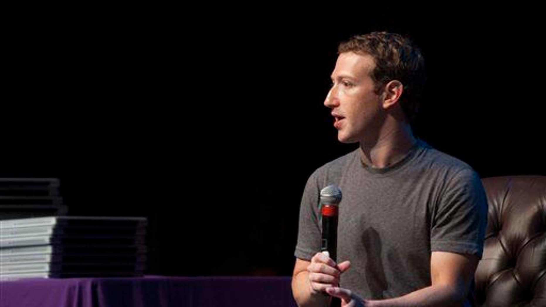 In a Sept. 18, 2014, file photo, Facebook CEO Mark Zuckerberg speaks to students during a special assembly at Sequoia High School in Redwood City, Calif.