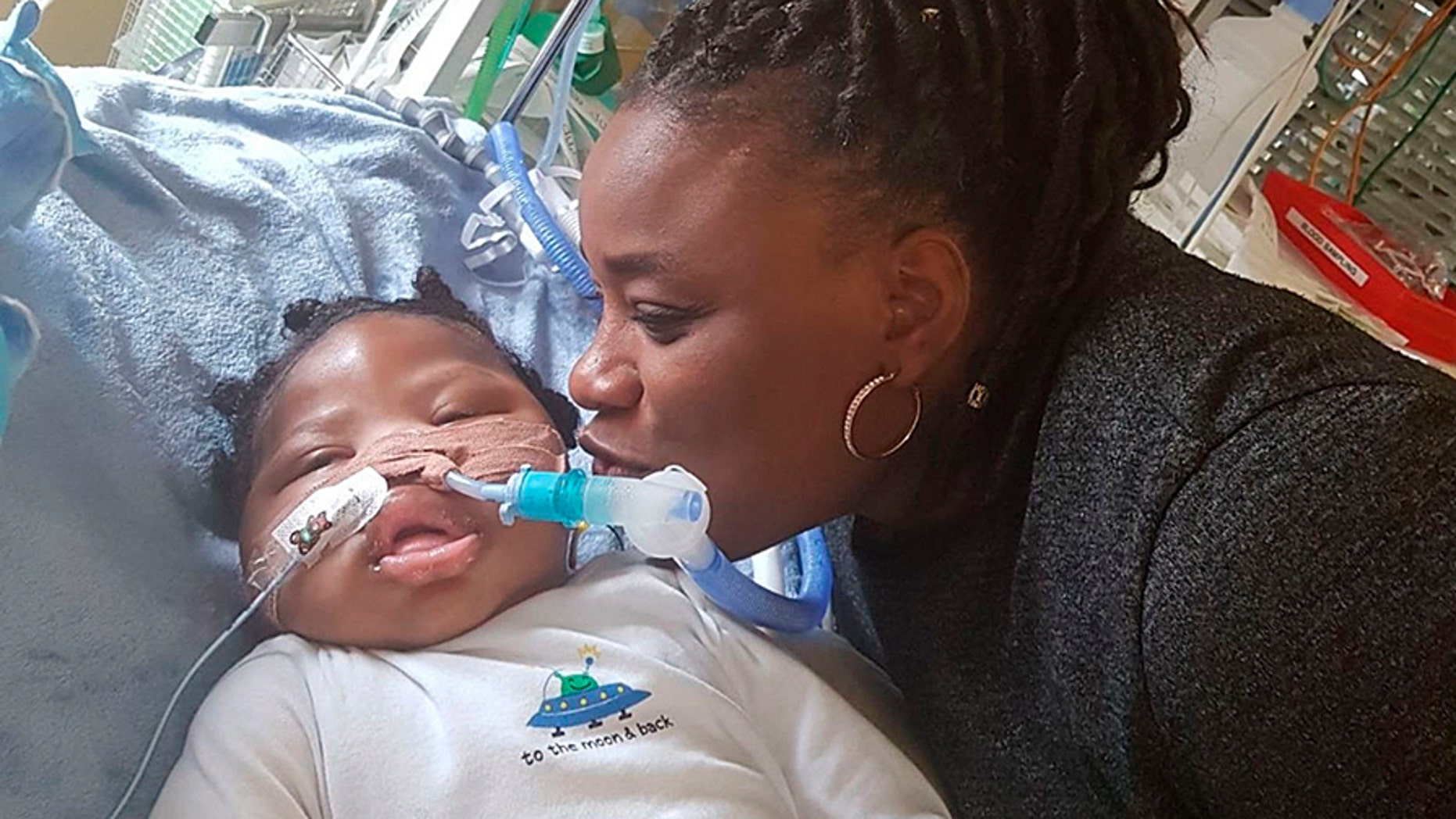 Isaiah Haastrup with his aunt Dahlia Thomas at King's College Hospital in London. A judge ruled that the 11-month-boy could be taken off life support despite the parents' objection.