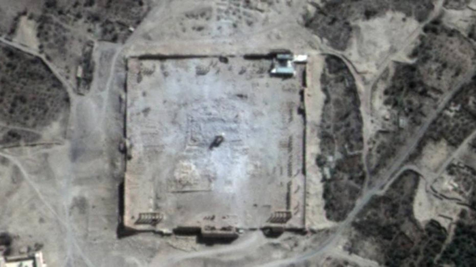 This Monday, Aug. 31, 2015 satellite image provided by UNITAR-UNOSAT shows damage to the main building of the ancient Temple of Bel in the Palmyra, Syria. The main building has been destroyed, a United Nations agency said. The image was taken a day after a massive explosion was set off near the 2,000-year-old temple in the city occupied by Islamic State militants. (UrtheCast, UNITAR-UNOSAT via AP)