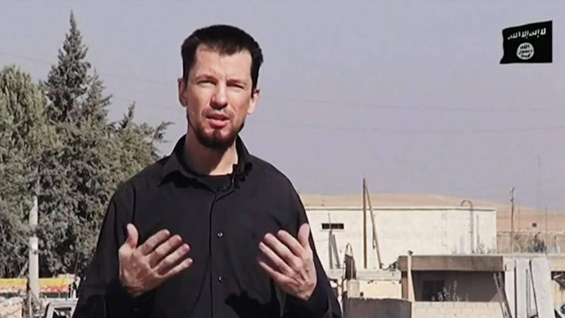In this still image taken from an undated video published on the Internet by the Islamic State group militants, captive British journalist John Cantlie speaks into a camera in what he identifies as the embattled Syrian town of Kobani. In the video, Cantlie says Islamic State fighters have pushed deeper into the town despite airstrikes by a U.S.-led coalition. It's the latest propaganda video in which Cantlie is exploited by the extremists to take on the role of a war correspondent. AP cannot verify the location independently. (AP Photo)