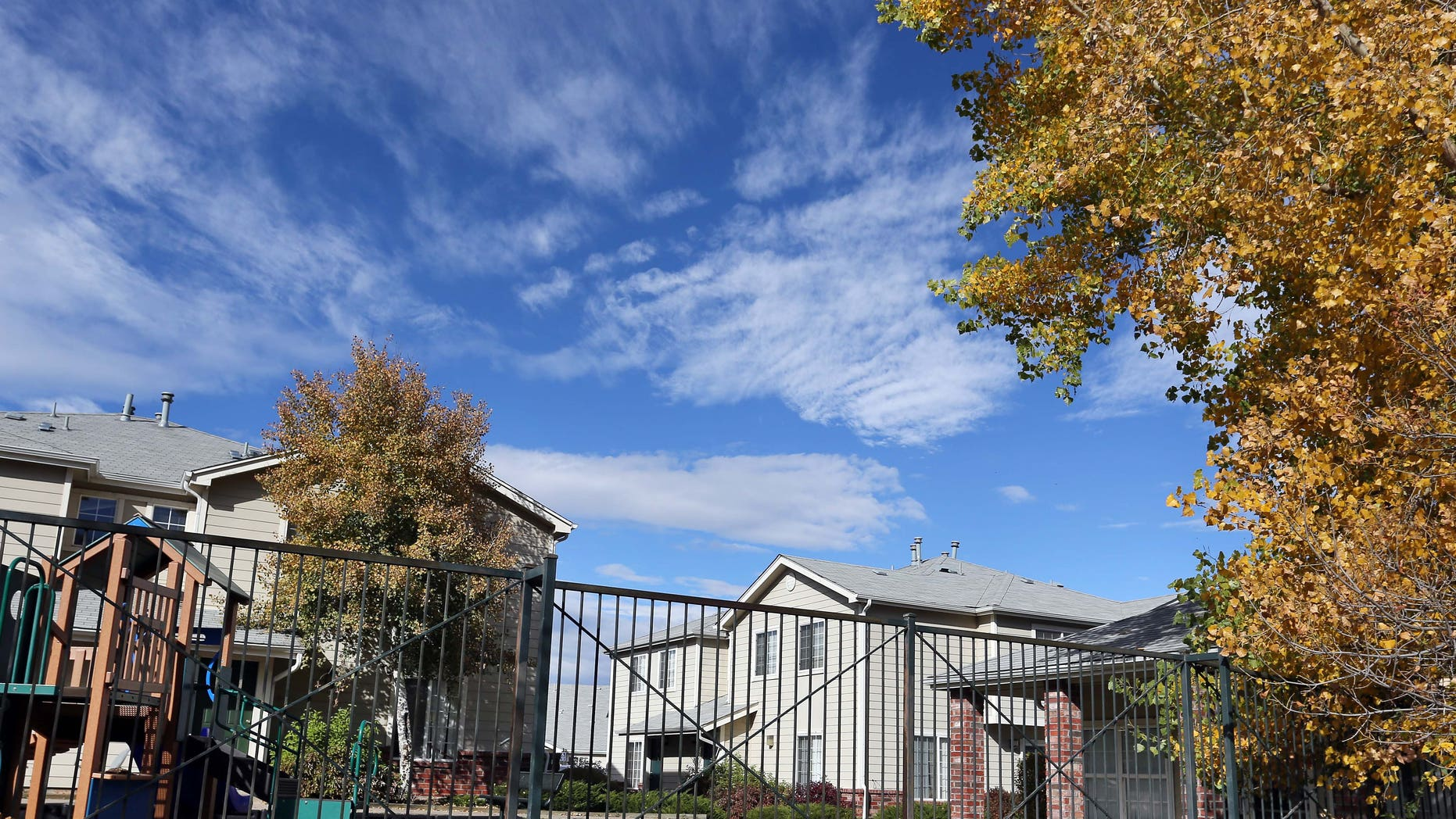 Oct. 22, 2014,: This photo shows the apartment complex in Aurora, Colo., which police say is the home of one of the three teenage girls who, according to U.S. authorities, were en route to join the Islamic State group in Syria when they were stopped at an airport in Germany. The two sisters, ages 17 and 15, and their 16-year-old friend have been reunited with their families in Colorado, according to an FBI spokeswoman. (AP/Brennan Linsley)