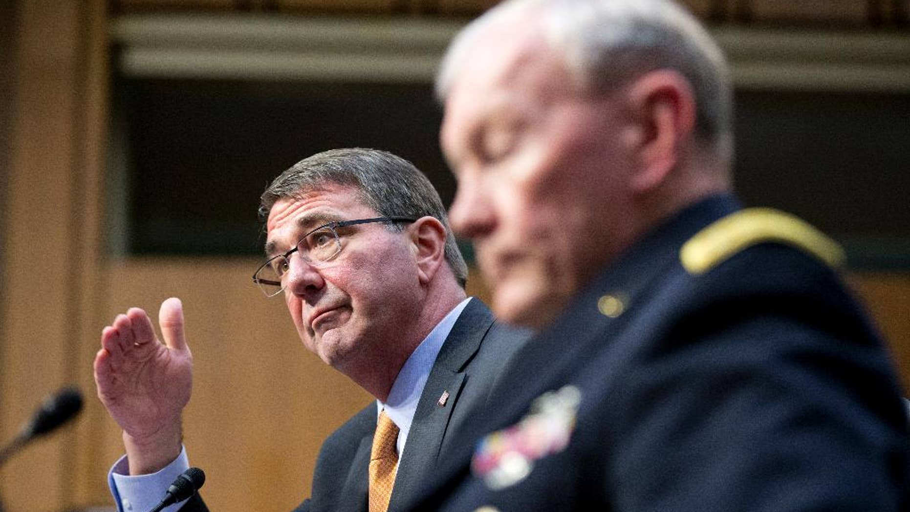"FILE - In this March 3, 2015 file photo, Defense Secretary Ash Carter, left, accompanied by Joint Chiefs Chairman Gen. Martin Dempsey, testifies on Capitol Hill in Washington before the Senate Armed Services Committee. Iran's growing influence in Iraq is setting off alarm bells, and nowhere is the problem starker than in the high-stakes battle for Tikrit. It marks a crucial fight in the bigger war to expel the Islamic State group from Iraq, and yet Iran and the Shiite militias it empowers _ not the U.S. _ are leading the charge. Carter, under questioning from Sen. John McCain this week, acknowledged his concern when McCain asked if it alarms him that Iran ""has basically taken over the fight."" (AP Photo/Manuel Balce Ceneta, File)"