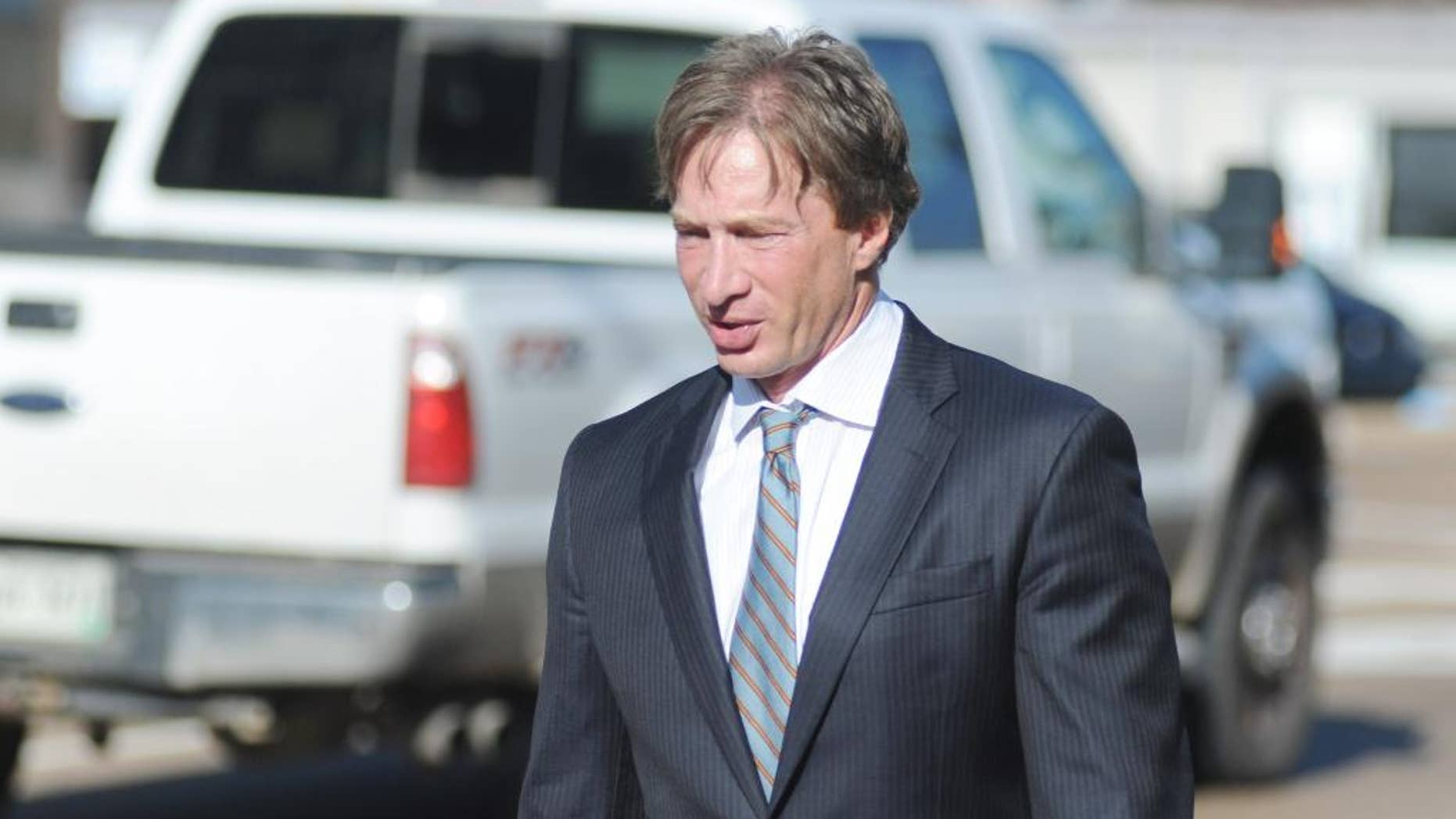 Attorney Ken Coghlan, representing Jaelyn Delshaun Young, enters federal court for a hearing in Oxford, Miss. on Tuesday, Aug. 11, 2015. Young, and Muhammad Oda Dakhlalla, were arrested over the weekend on charges that they were trying to travel abroad to join the Islamic State militant group. (Bruce Newman/Oxford Eagle via AP)