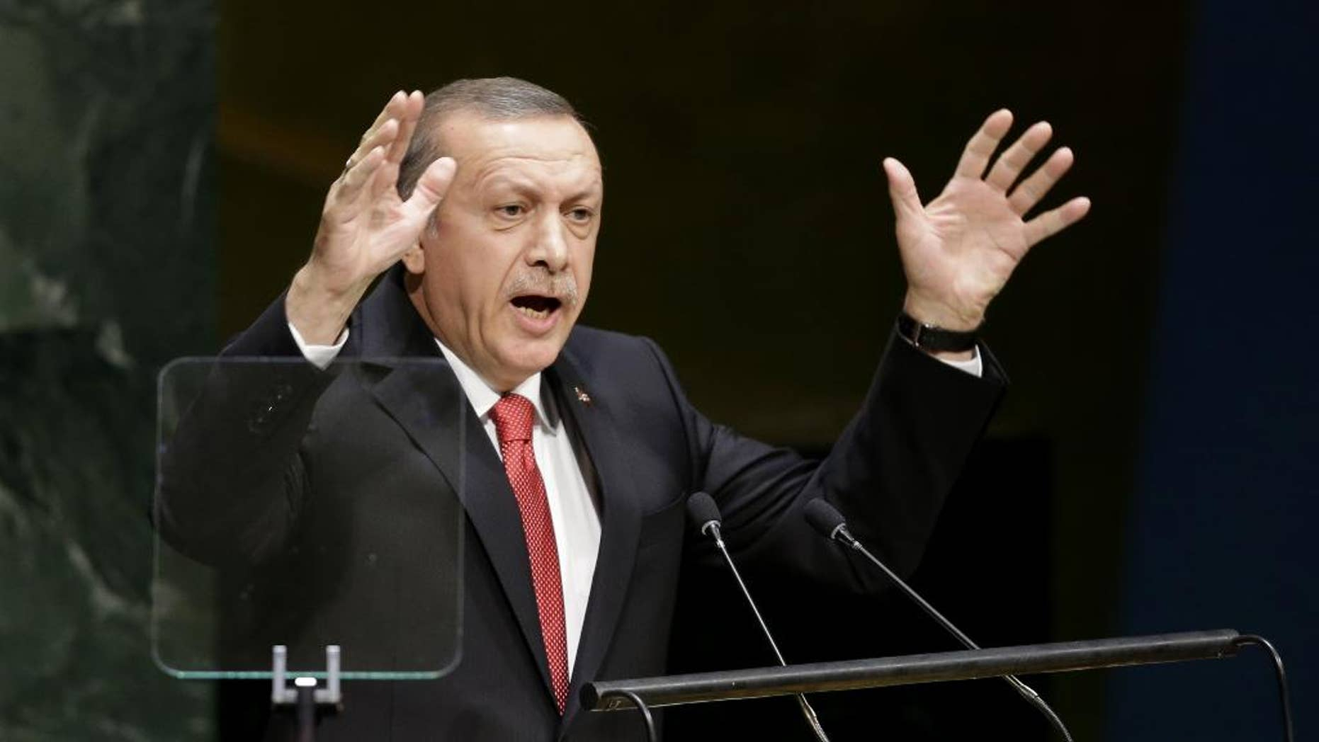 "In this Sept. 24, 2014, photo, Turkish President Recep Tayyip Erdogan speaks during the 69th session of the United Nations General Assembly at U.N. headquarters. Moving from reluctance to refusal and finally to acceptance, Turkey is joining its NATO allies and fellow Sunni Muslim nations in a coalition to destroy the Islamic State militant group. But the U.S. is still waiting for details of any new, specific, aid and is warily watching to make sure Ankara keeps its commitments. Erdogan also told reporters on Tuesday, ""Of course, we will do our part.""  (AP Photo/Seth Wenig)"
