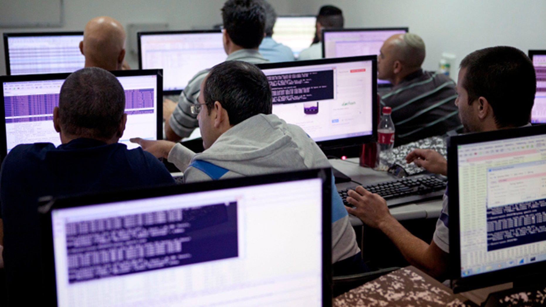 Oct. 20, 2013: Israelis work on computers at the 'CyberGym' school in the coastal city of Hadera. When Israel's military chief delivered a high-profile speech this month outlining the greatest threats his country will face in the future, he listed computer sabotage as a top concern, warning a sophisticated cyber attack could one day bring the nation to a standstill.