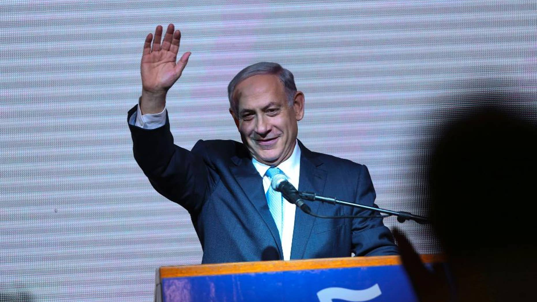 FILE - In this March 18, 2015, file photo, Israeli Prime Minister Benjamin Netanyahu greets supporters at the party's election headquarters in Tel Aviv. Netanyahu apologized to Israel's Arab citizens on Monday, March 23, 2015, for remarks he made during last week's parliament election that offended members of the community. (AP Photo/Oded Balilty, File)