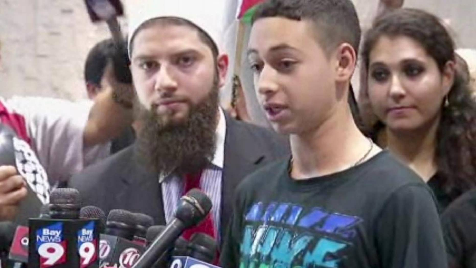 This image from an AP video shows Tariq Abu Khdeir, the Palestinian-American teen who relatives allege was beaten by Israeli authorities earlier this month addressing the media after arriving at at Tampa International Airport on Wednesday night, July 16, 2014, in Tampa, Fla. (AP Photo/AP Video)