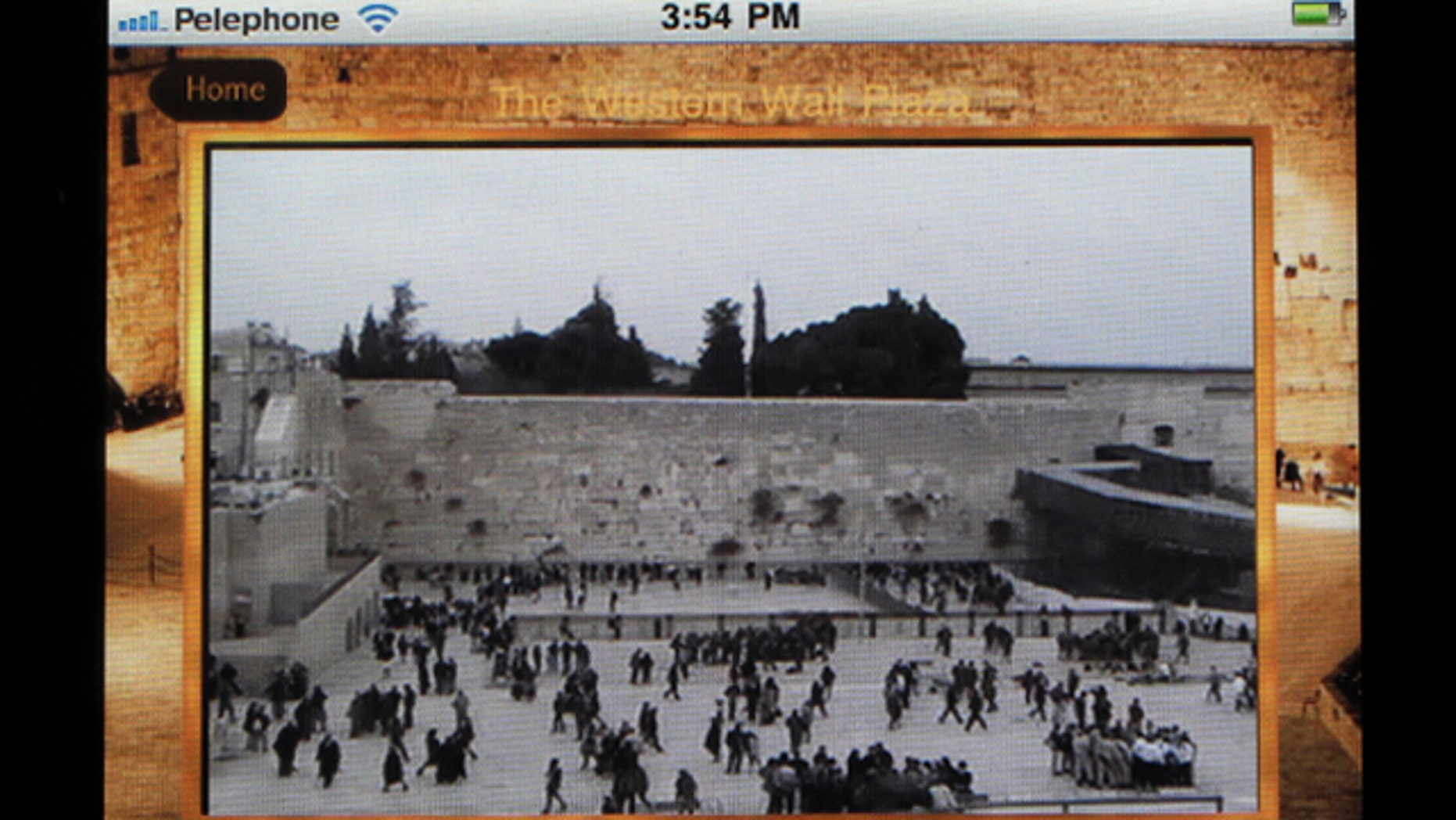 """A live webcam broadcast from the Western Wall in Jerusalem's Old City is seen on a new iPhone app, Wednesday, Dec. 29, 2010. Michal Ophir of the Israeli foundation that developed the app said Wednesday that it """"brings the Western Wall to every Jew in the world because it is the heart of the Jewish people."""""""
