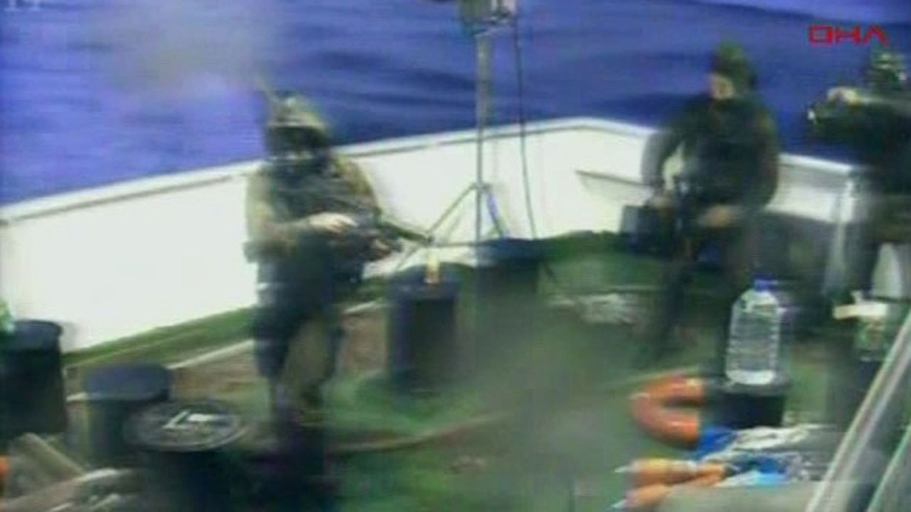 May 31: This video image released by the Turkish Aid group IHH purports to show Israeli soldiers aboard a military vessel in international waters off the Gaza coast surrounding a Turkish ship.