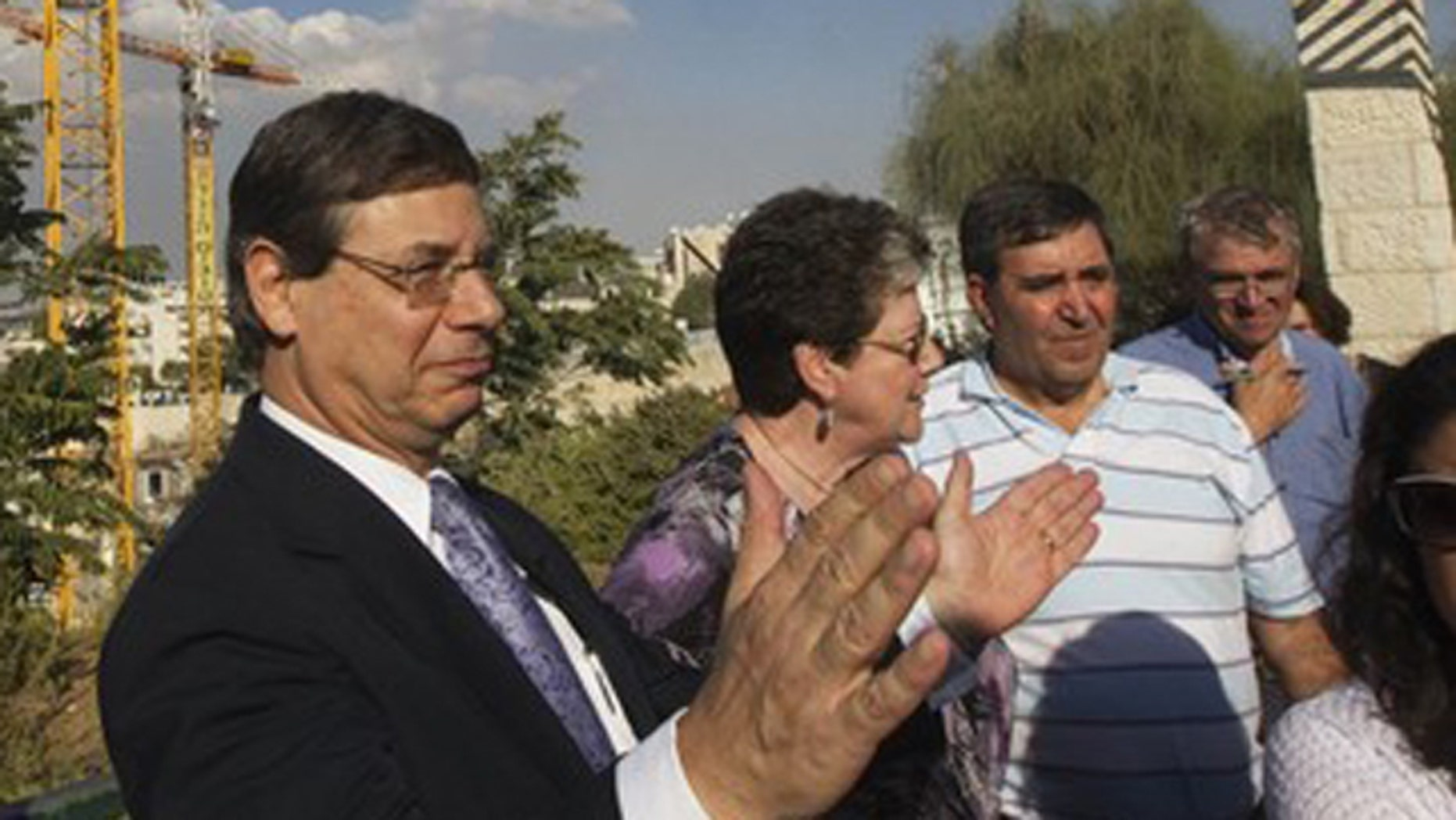 FILE: Israel's Deputy Foreign Minister Danny Ayalon (C) gestures as he speaks to the media during a tour of Gilo, a Jewish settlement on land Israel captured in 1967 and annexed to its Jerusalem municipality.