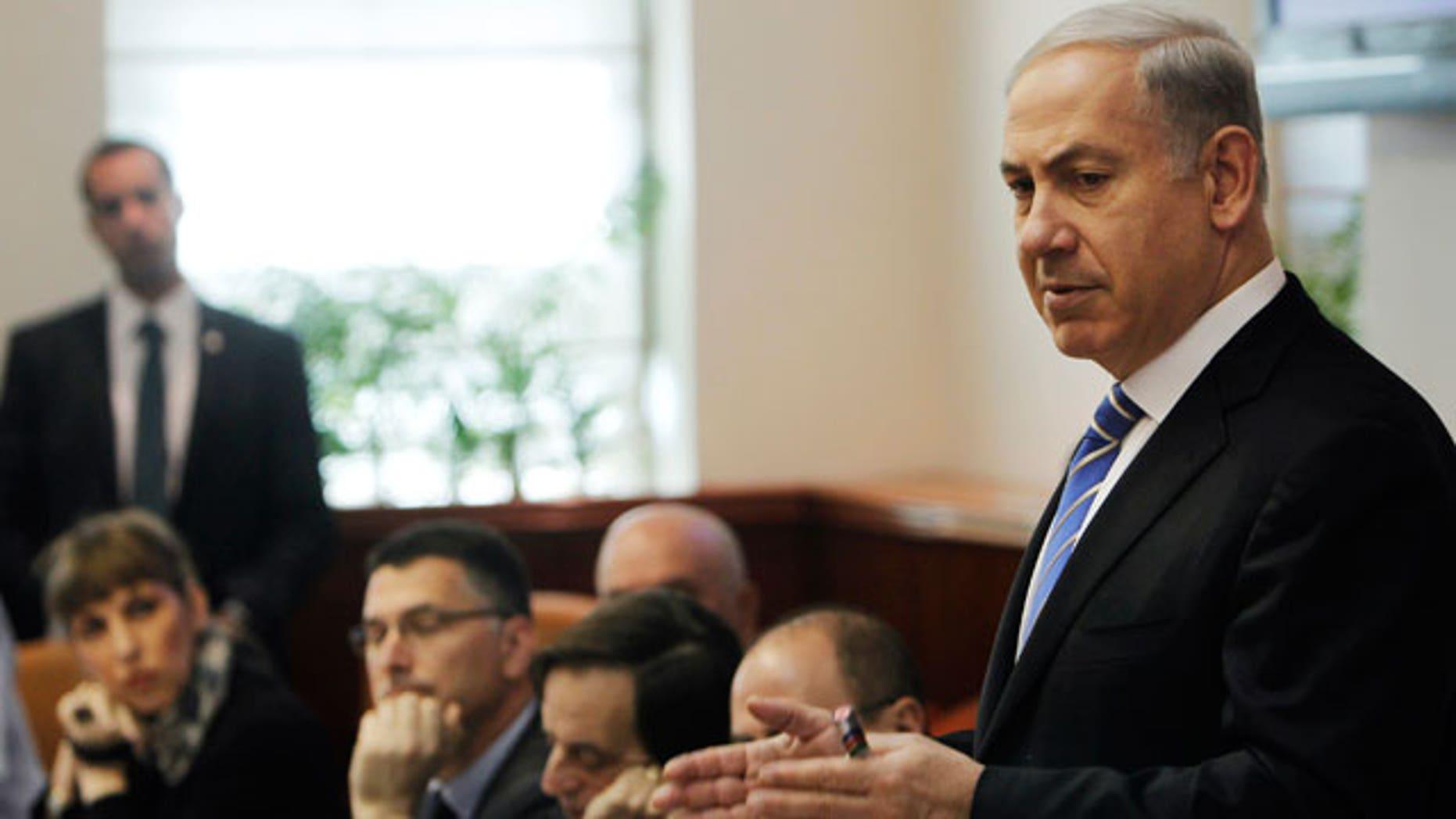 Jan. 1, 2012: Israel's Prime Minister Benjamin Netanyahu, right, speaks during the weekly cabinet meeting in Jerusalem.