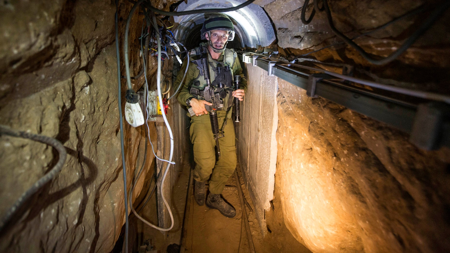 An Israeli army officer gives explanations to journalists during an army organised tour in a tunnel said to be used by Palestinian militants for cross-border attacks.