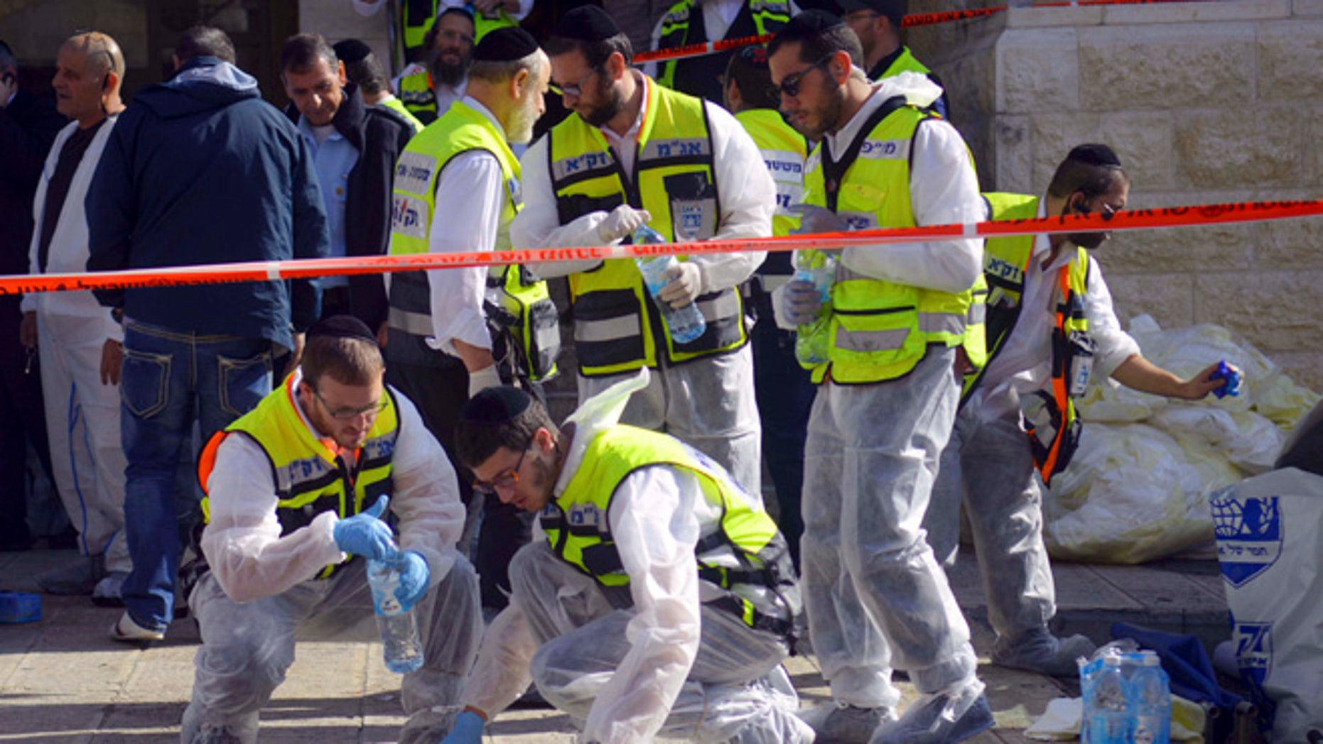 Nov. 18, 2014: Paramedics wipe the blood from pavement outside a synagogue after a shooting attack in Jerusalem. (AP)