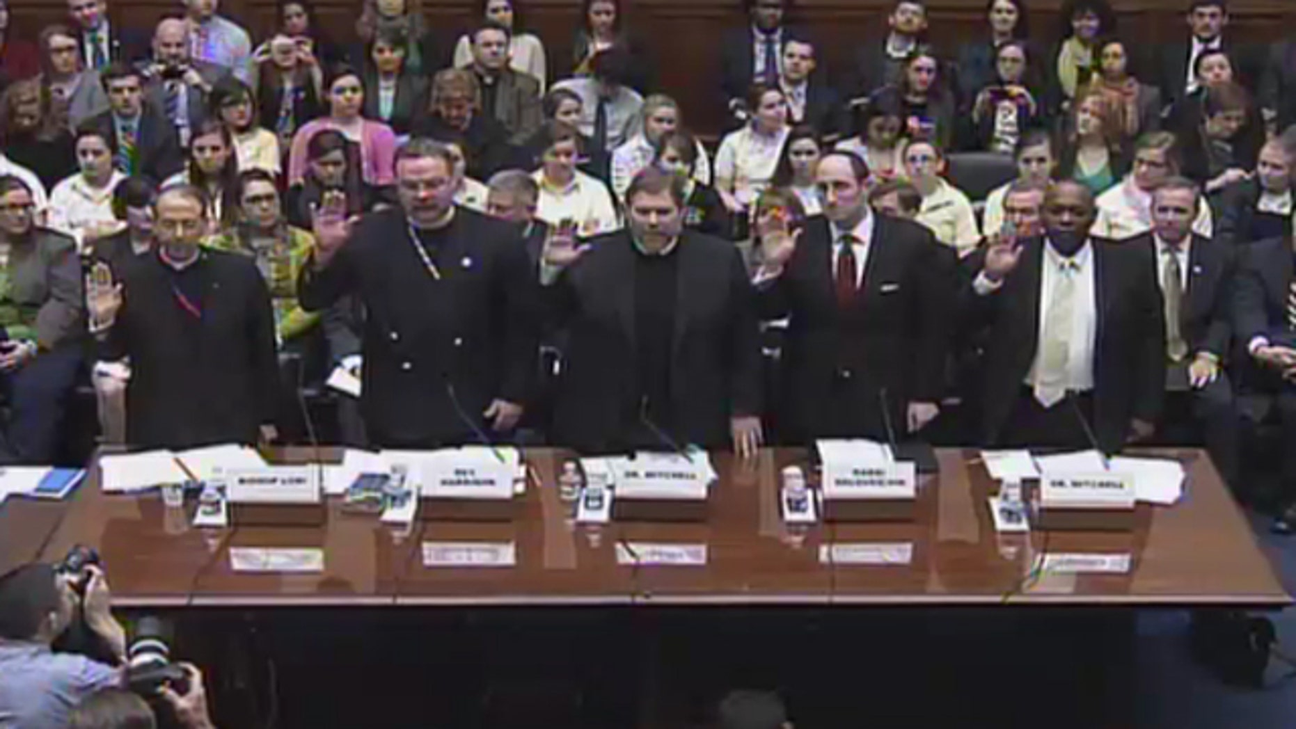 Feb. 16, 2012: Religious leaders take an oath before testifying on Capitol Hill about the administration's contraceptive policy and religious freedom.