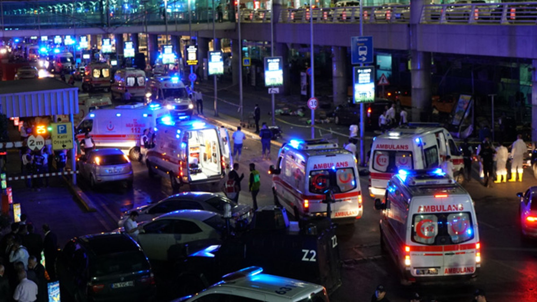 ISTANBUL, TURKEY - JUNE 28: Security and ambulances block the road outside Turkey's largest airport, Istanbul Ataturk, after it was hit by a suicide bomb attack on June 28, 2016, Turkey. Two suicide bombers opened fire before blowing themselves up at the entrance to the main international airport in Istanbul, killing at least 10 people and wounding at least 60 people according to Justice Minister Bekir Bozdagç. (Photo by Mehmet Ali Poyraz/Getty Images)