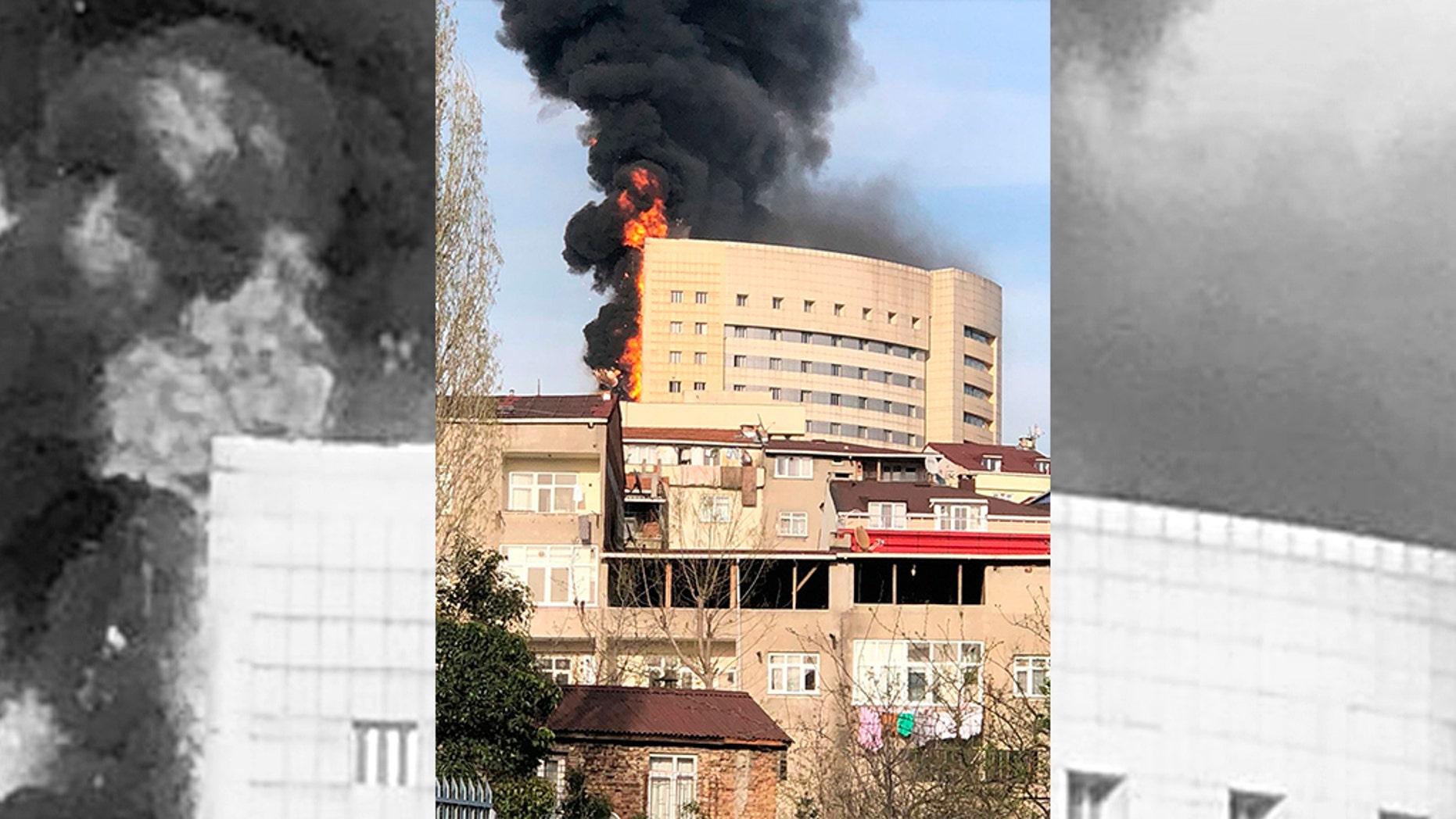 A fire engulfing a facade of the Taksim Ilk Yardim hospital in the Gaziosmanpasa district in Istanbul, Thursday, April 5, 2018.
