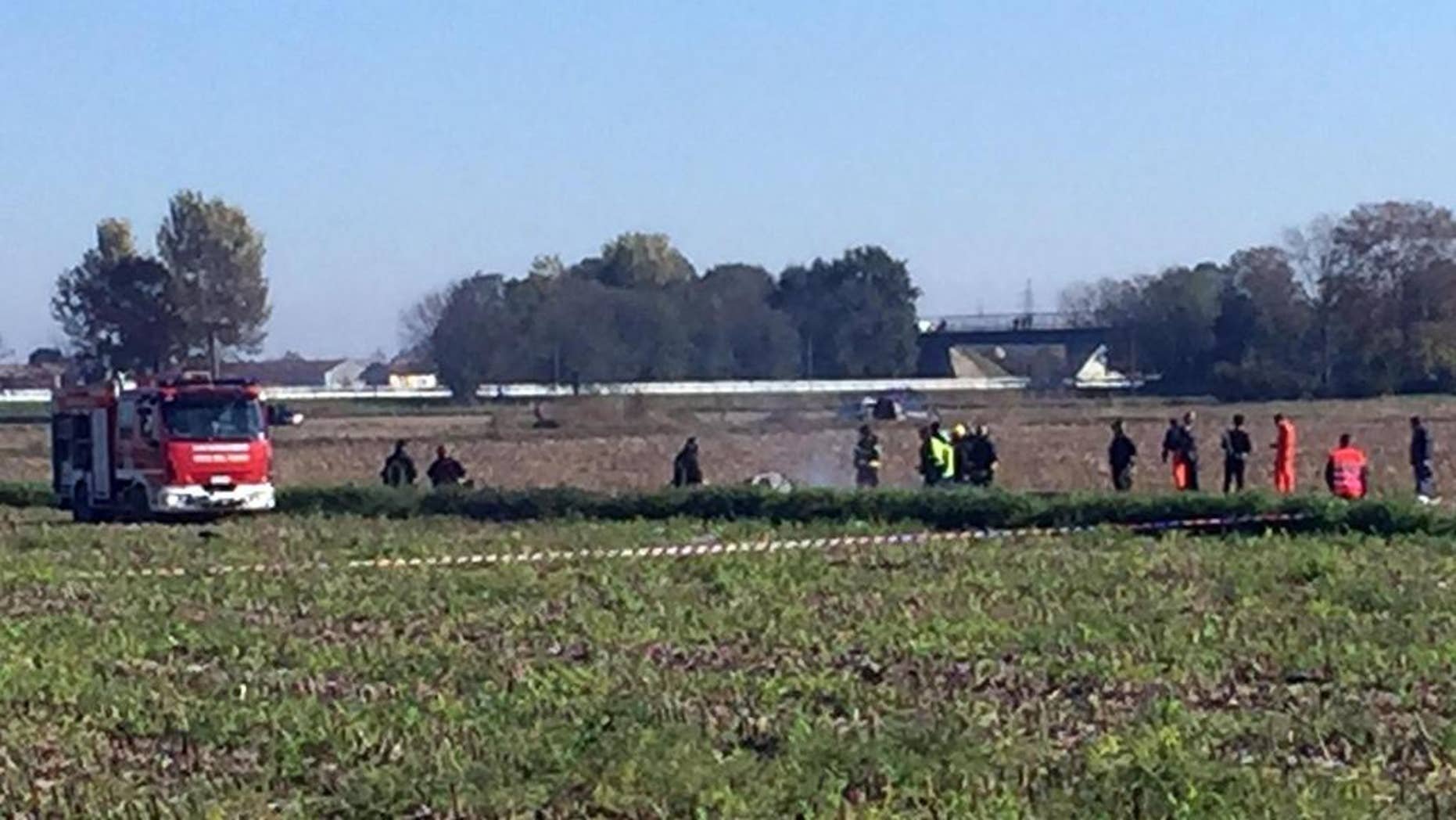 Rescue teams operate in the area where an aircraft crashed in a mid-air incident, in Santhia, near Vercelli, Italy, Friday, Oct. 30, 2015. The AgustaWestland helicopter maker says that a prototype of one of its aircraft was involved in a mid-air accident that killed both occupants in northern Italy. (Roberto Maggio/ANSA via AP) ITALY OUT