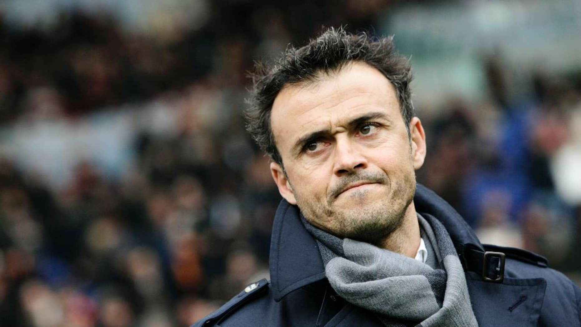 FILE - In this Sunday, Feb. 19, 2012, file photo, AS Roma coach Luis Enrique, of Spain, waits for the start of a Series A soccer match between AS Roma and Parma, at Rome's Olympic stadium. Barcelona has hired Luis Enrique as its new coach, succeeding Gerardo Martino who stepped down on Saturday after the club failed to defend its Spanish league title. Barcelona said on its website Monday, May 19, 2014, that Enrique has agreed to a two-year deal. (AP Photo/Riccardo De Luca, File)