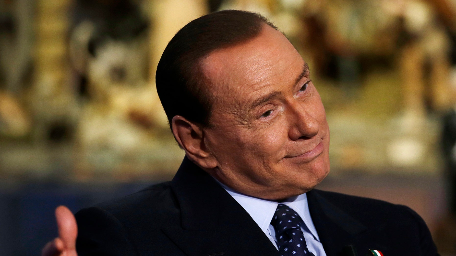"""Dec. 18, 2012: Former Italian Premier and People of Freedom party Leader Silvio Berlusconi  gestures while attending the recording of RAI (Italian State Television) TV talk show """"Porta a Porta""""(Door to Door) hosted by journalist Bruno Vespa, in Rome."""