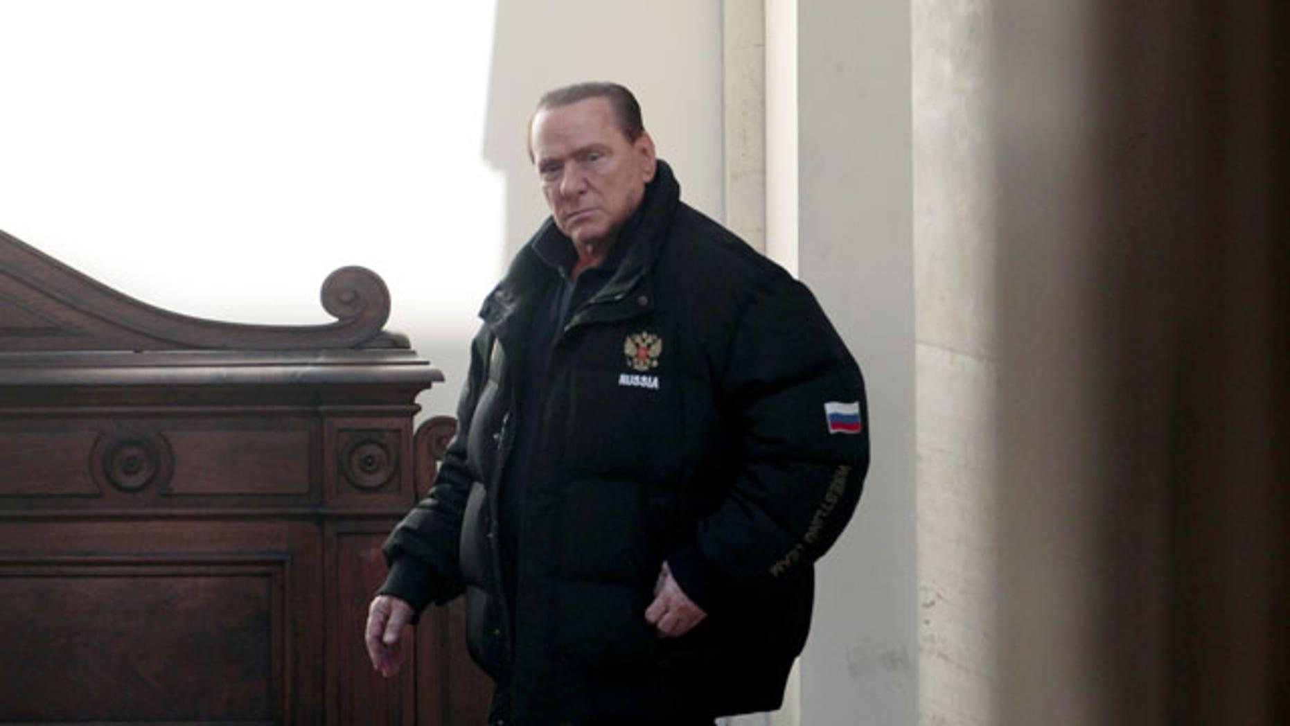 Feb. 25, 2012: Former Italian premier Silvio Berlusconi leaves his residence Palazzo Grazioli in Rome.