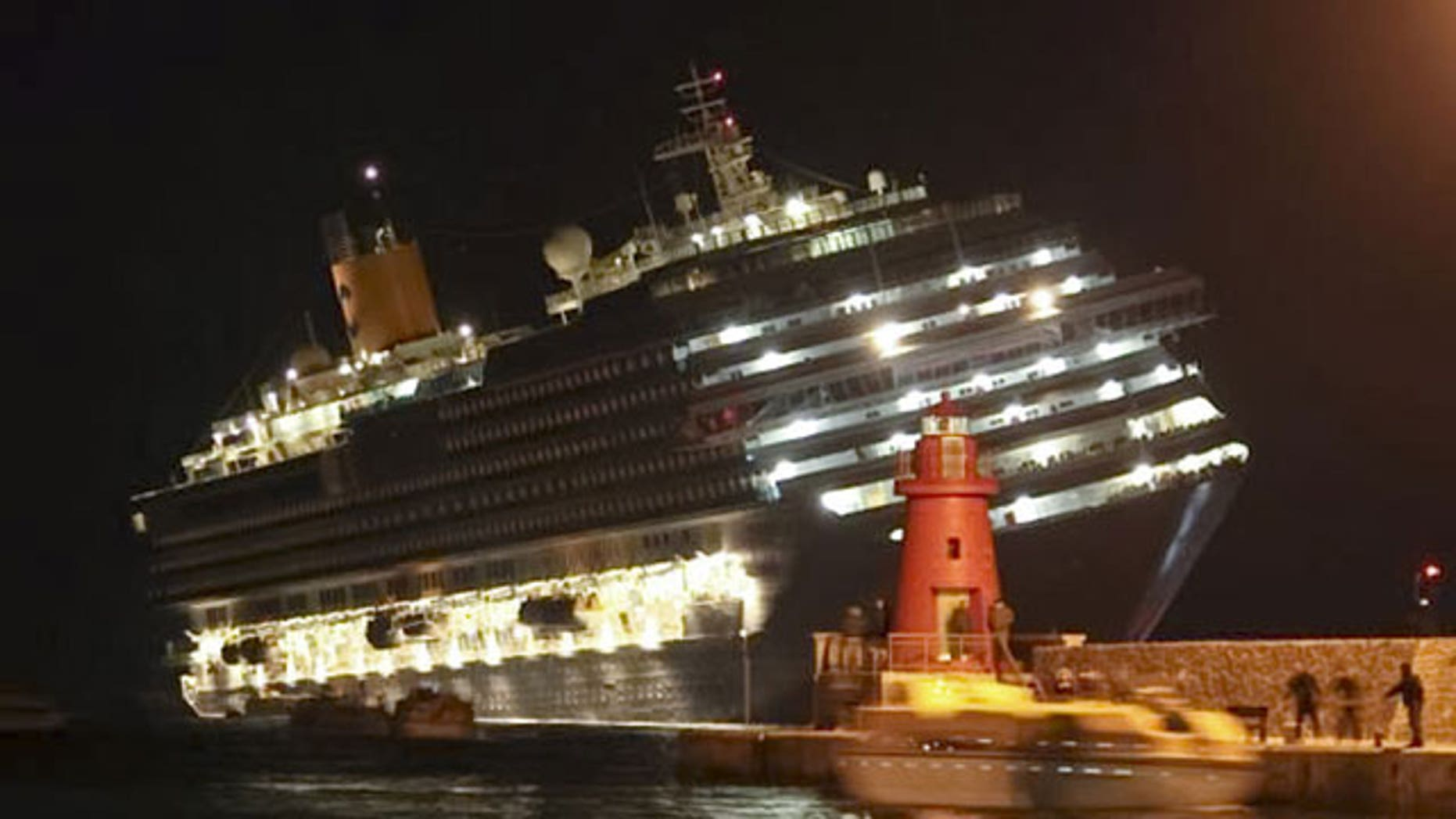 January 14, 2012: The luxury cruise ship Costa Concordia leans after it ran aground off the coast of Isola del Giglio island, Italy, gashing open the hull and forcing some 4,200 people aboard to evacuate aboard lifeboats to the nearby Isola del Giglio island.