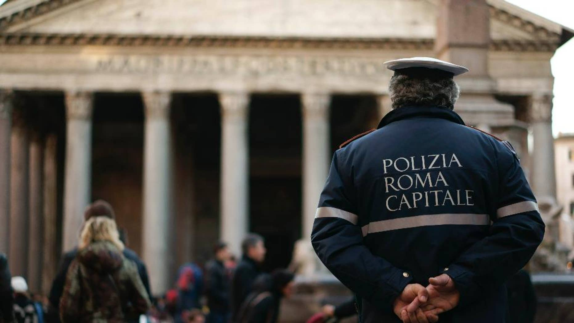 An Italian municipal policeman stands in front of Rome's Pantheon in Rome, Monday, Jan. 5, 2015. Italian government has sent in inspectors to Rome after about 85 percent of the officer called in sick on New Year's Eve. (AP Photo/Andrew Medichini)