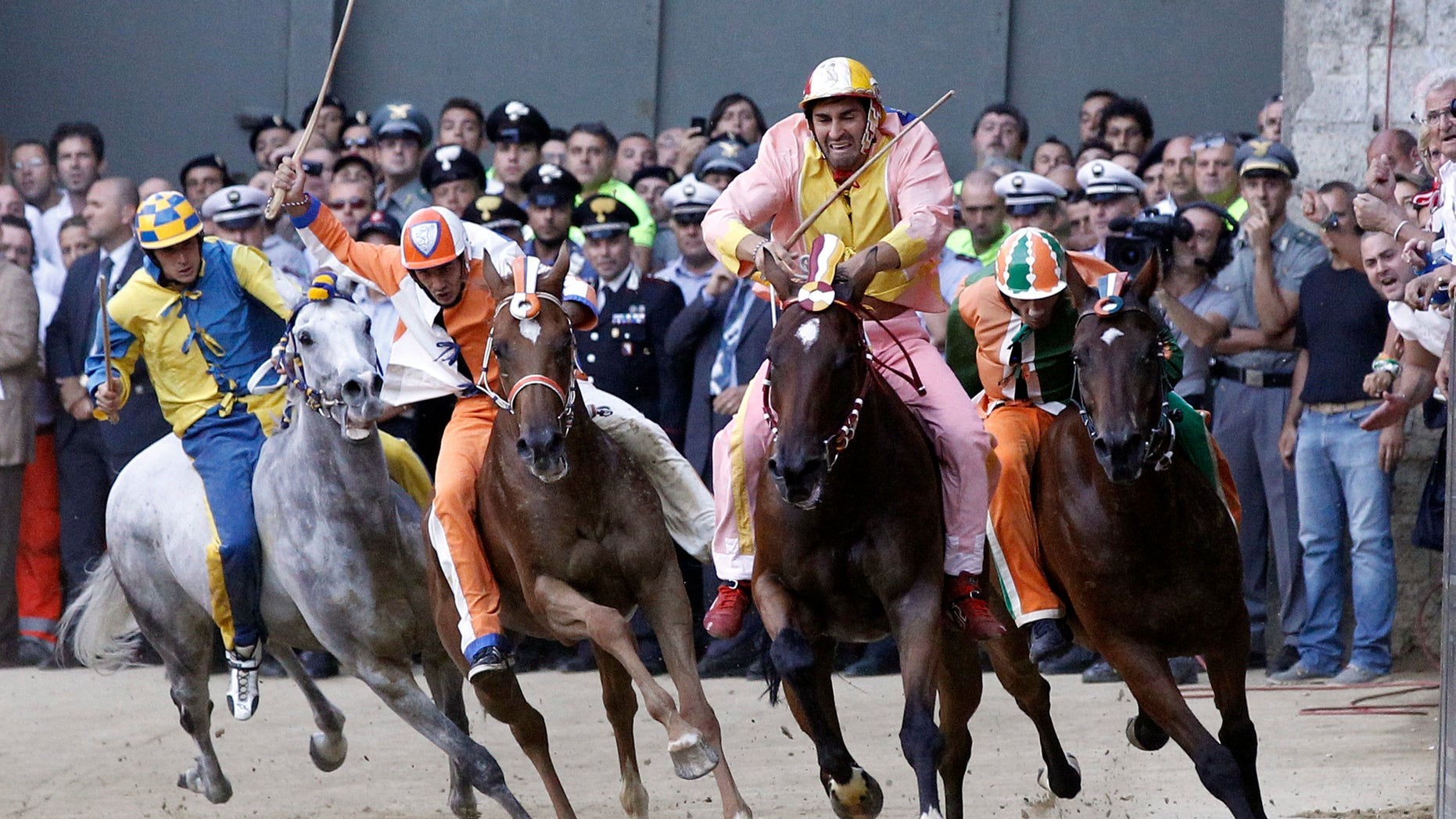Aug. 16, 2012: The Montone (Ram) neighborhood rider Jonathan Bartoletti, second from right, leads the race on his way to win the Madonna dell'Assunta (Virgin of the Assumption) ancient Palio, the famous break-neck bareback horse race run in Siena's main square, in Siena , Italy.